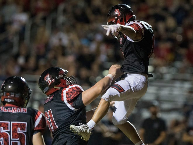 Liberty's Jake Morris gets thrown in the air by his lineman Frank Thompson after scoring a touchdown against Leland (CA) during their game Friday, Sept.14, 2018. #azhsfb