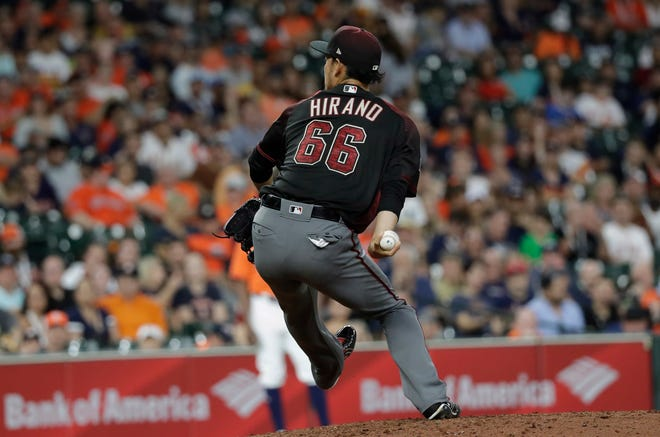 Arizona Diamondbacks relief pitcher Yoshihisa Hirano throws against the Houston Astros during the ninth inning of a baseball game Friday, Sept. 14, 2018, in Houston.