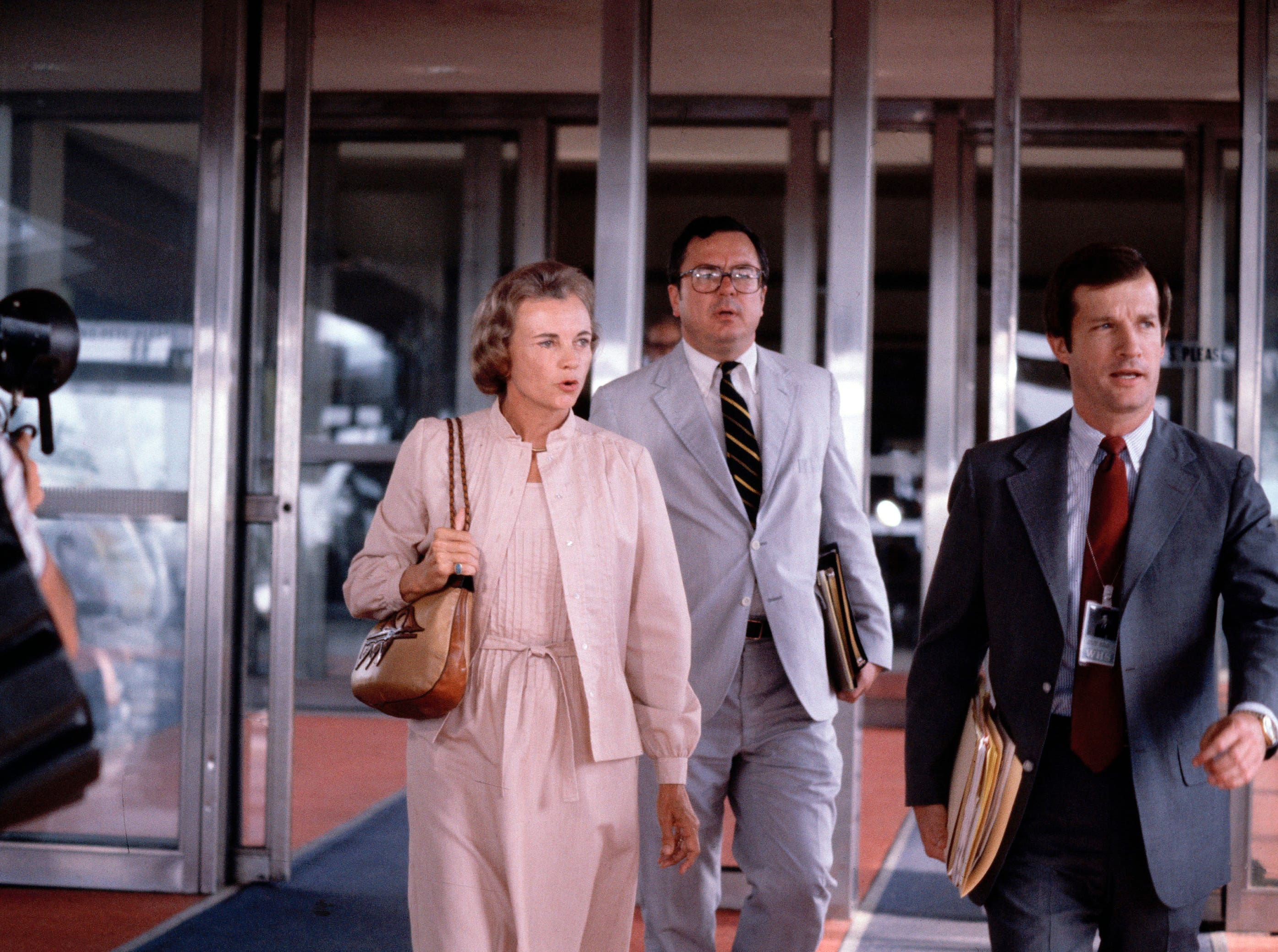 Supreme Court nominee Sandra Day O'Connor leaves Washington National Airport, July 1981.  Others are unidentified.