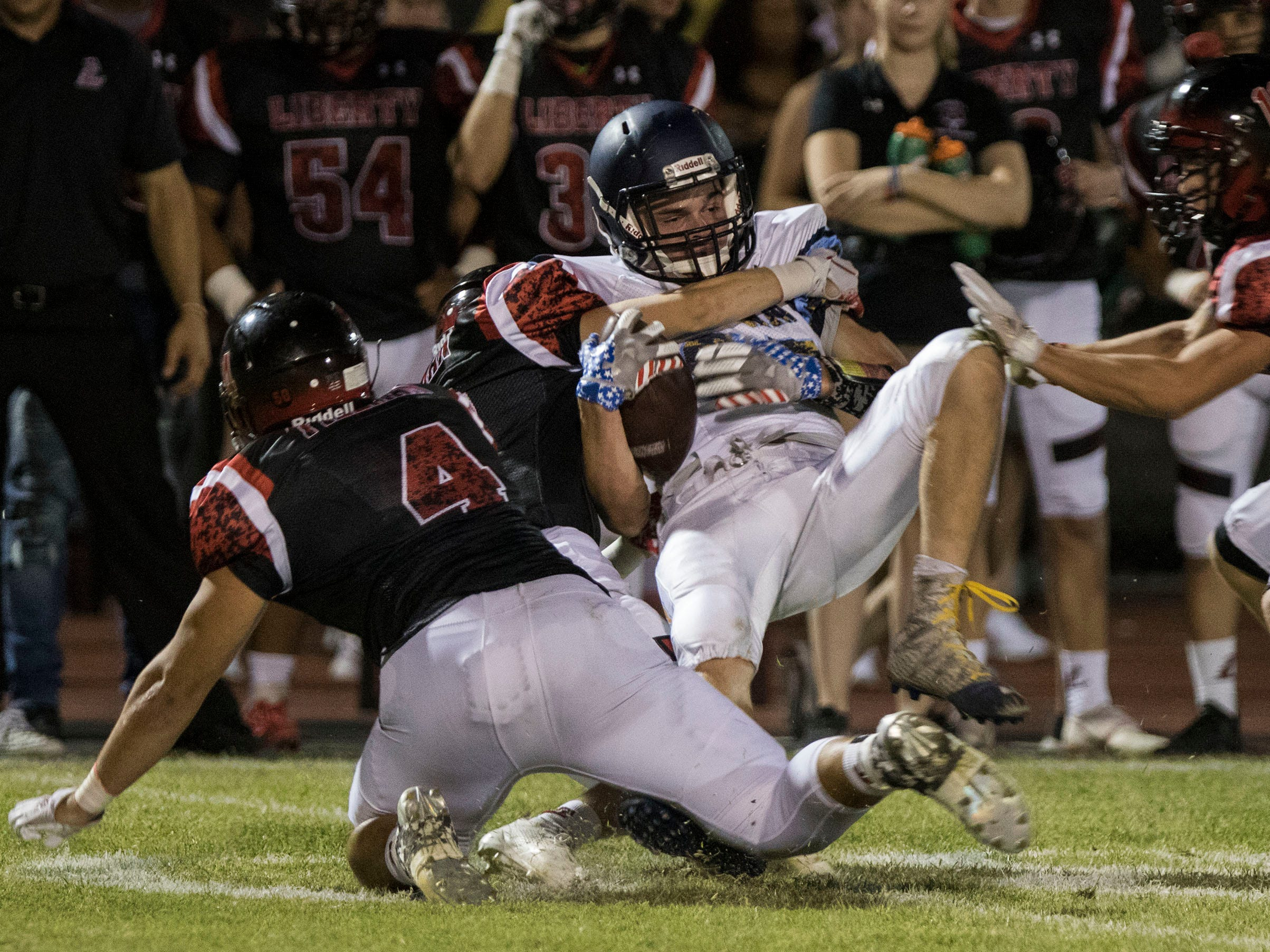 Leland's Preston Gook gets upended by Liberty's defense during their game in Peoria Friday, Sept.14, 2018. #azhsfb