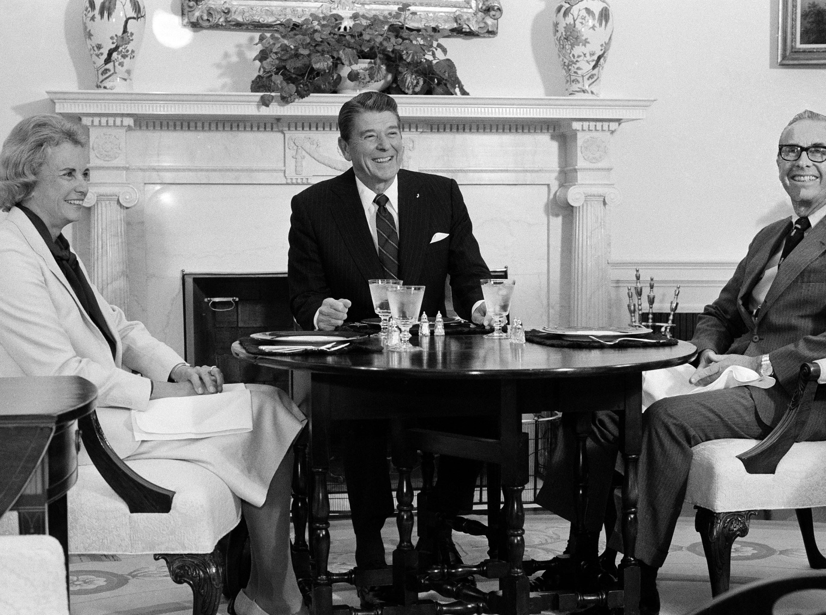 President Reagan poses with Supreme Court Justice Sandra Day O'Connor and her husband John J. O'Connor, right, in Oval Office, Sept. 23, 1983.  Justice O'Connor and her husband were guests of the president who was recognizing the second anniversary of her appointment to the Supreme Court.