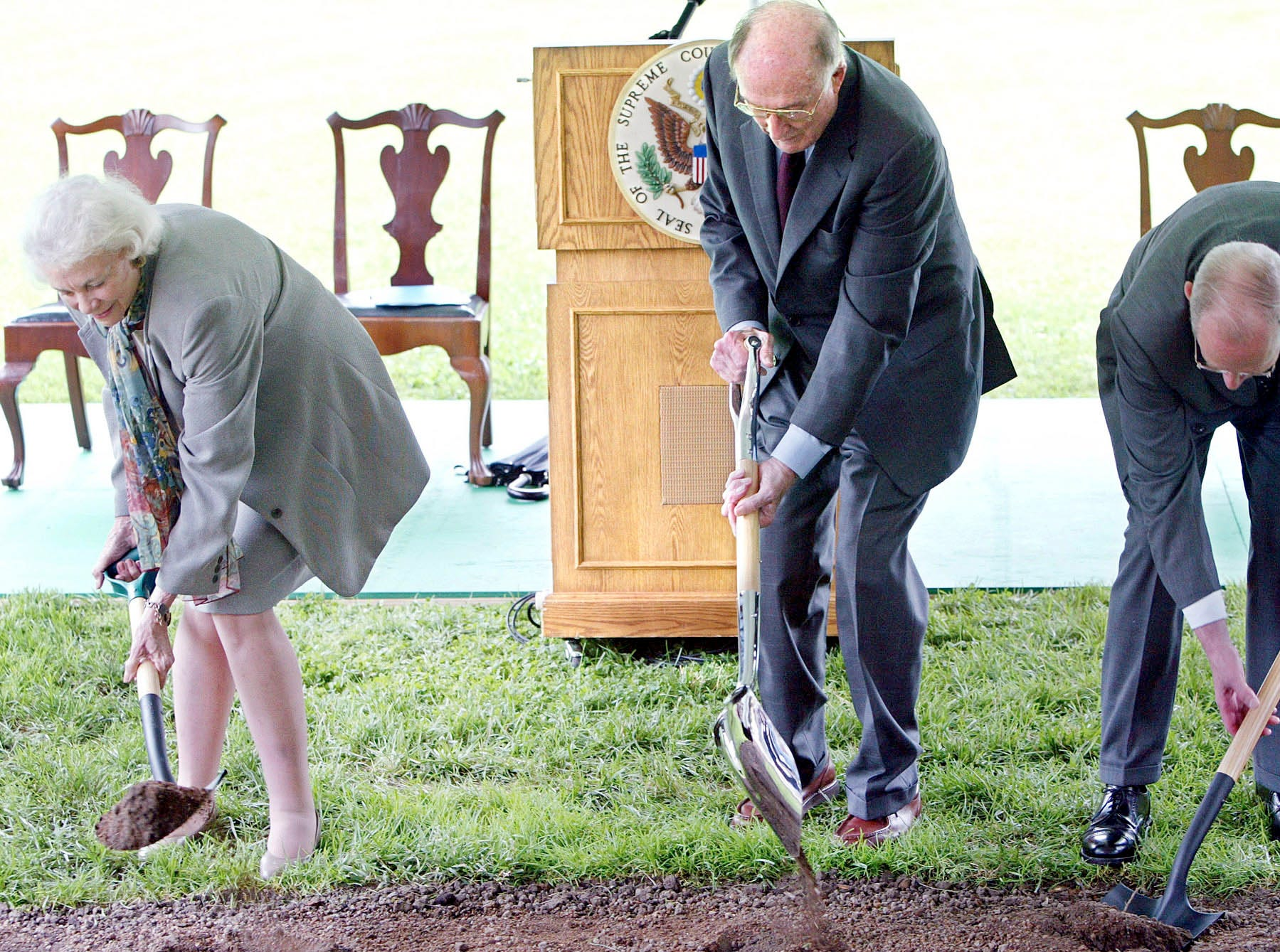 Supreme Court Associate Justice Sandra Day O'Connor, Chief Justice of the United States William H. Rehnquist  and Associate Justice Anthony M. Kennedy break ground on June 17, 2003, at a ceremony for a new section of the Supreme Court in Washington, D.C.