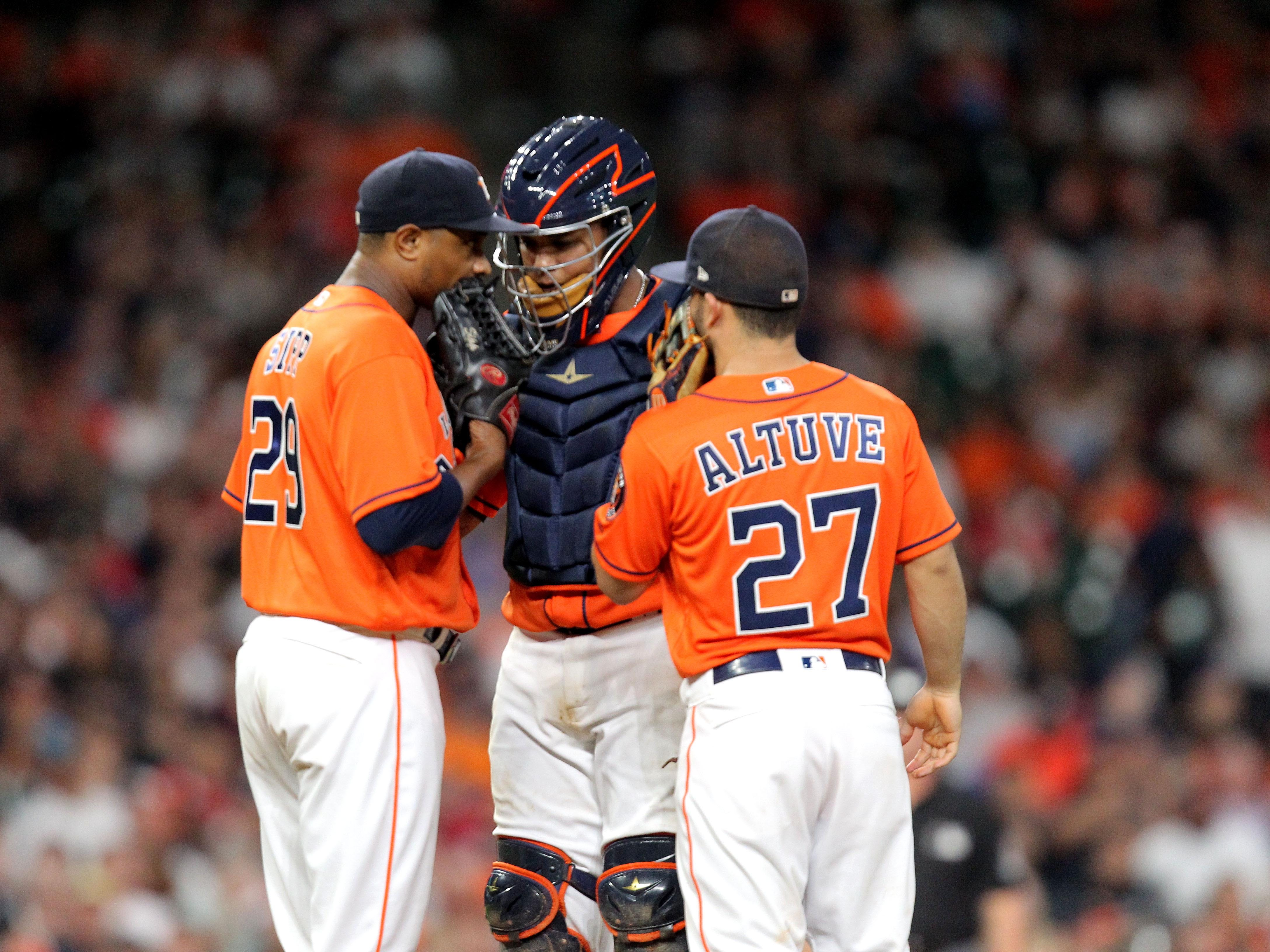 Sep 14, 2018: Houston Astros relief pitcher Tony Sipp (29, left) and Houston Astros second baseman Jose Altuve (27, right) meet with Houston Astros catcher Martin Maldonado (15, center) at the pitcher's mound during the seventh inning against the Arizona Diamondbacks at Minute Maid Park.
