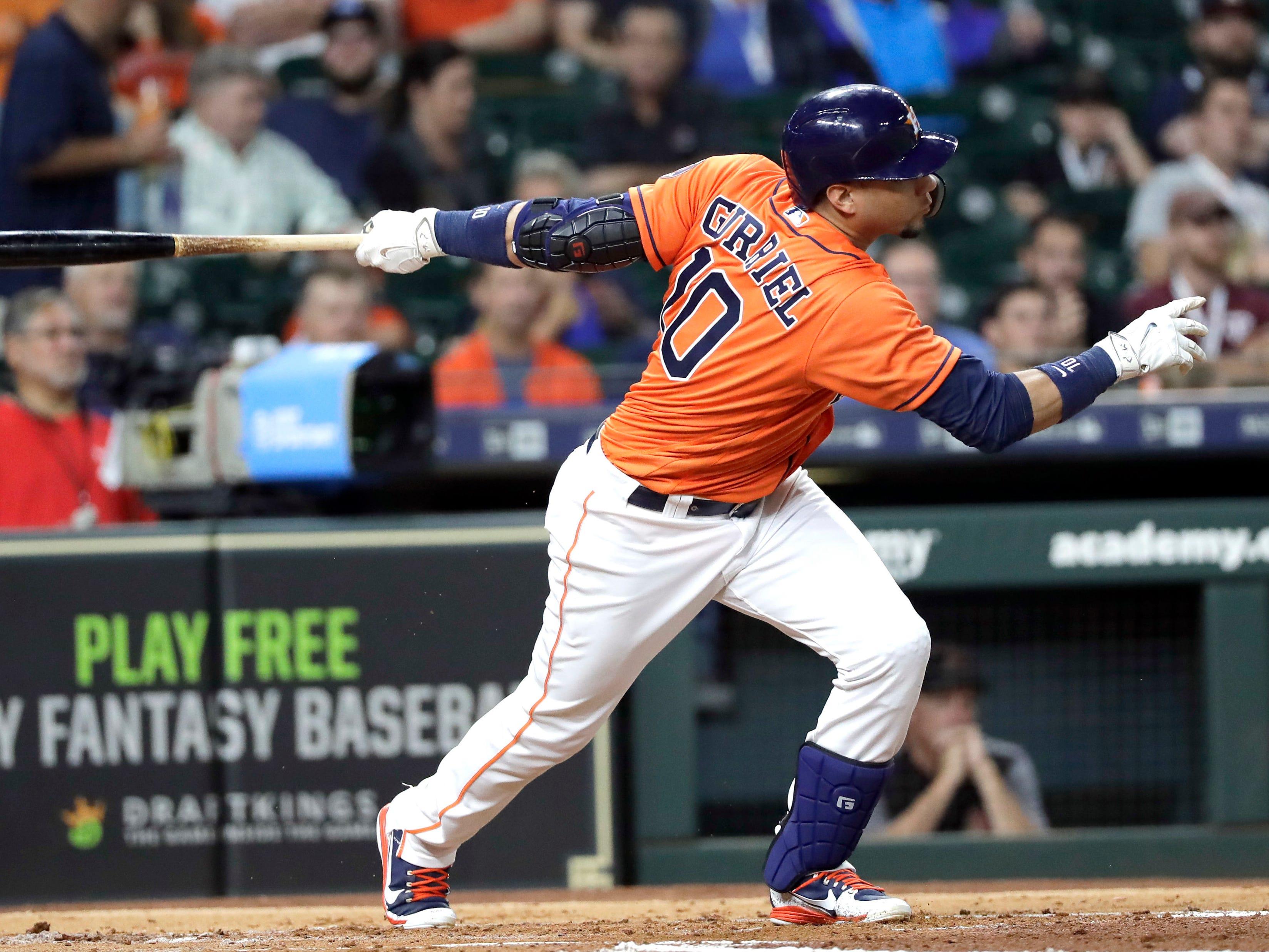 Houston Astros' Yuli Gurriel hits an RBI single against the Arizona Diamondbacks during the first inning of a baseball game Friday, Sept. 14, 2018, in Houston.