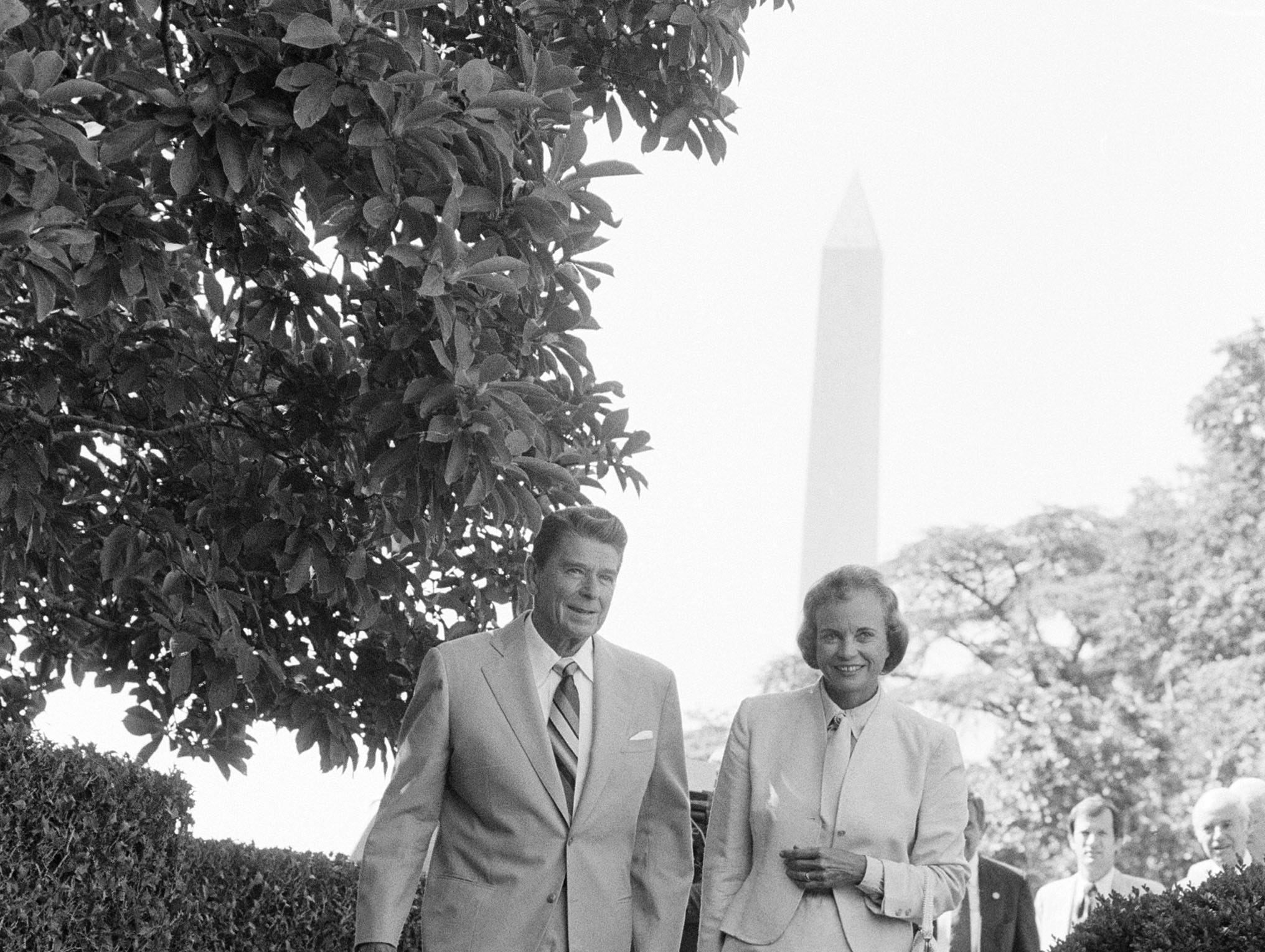 President Reagan and Supreme Court nominee Sandra Day O'Connor take the scenic route through the Rose Garden at the White House, July 15, 1981, as they prepare to pose for pictures prior to the start of their meeting at the Oval Office.