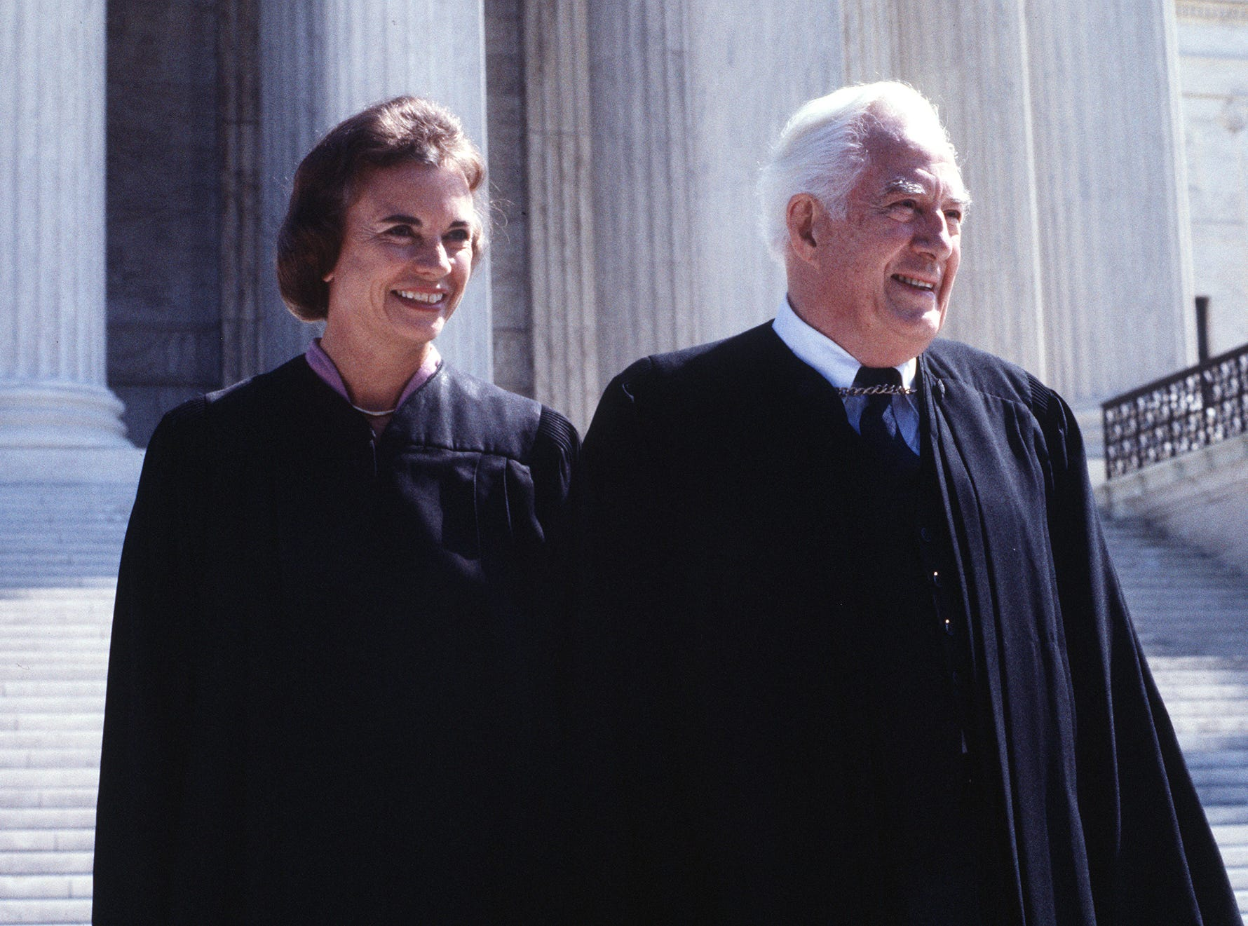 Supreme Court Associate Justice Sandra Day O'Connor poses with Chief Justice Warren Burger after her swearing in at the Supreme Court in Washington, D.C. Sept. 25, 1981.