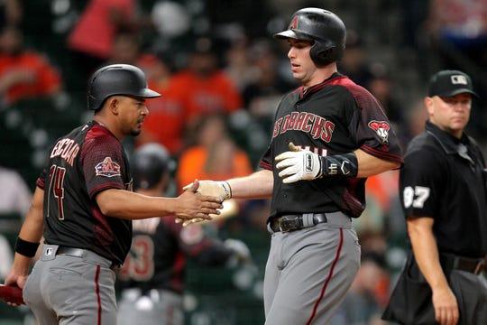 Sep 14, 2018: Arizona Diamondbacks first baseman Paul Goldschmidt (44) shakes hands with Arizona Diamondbacks third baseman Eduardo Escobar (14) after scoring a run against the Houston Astros during the first inning at Minute Maid Park.