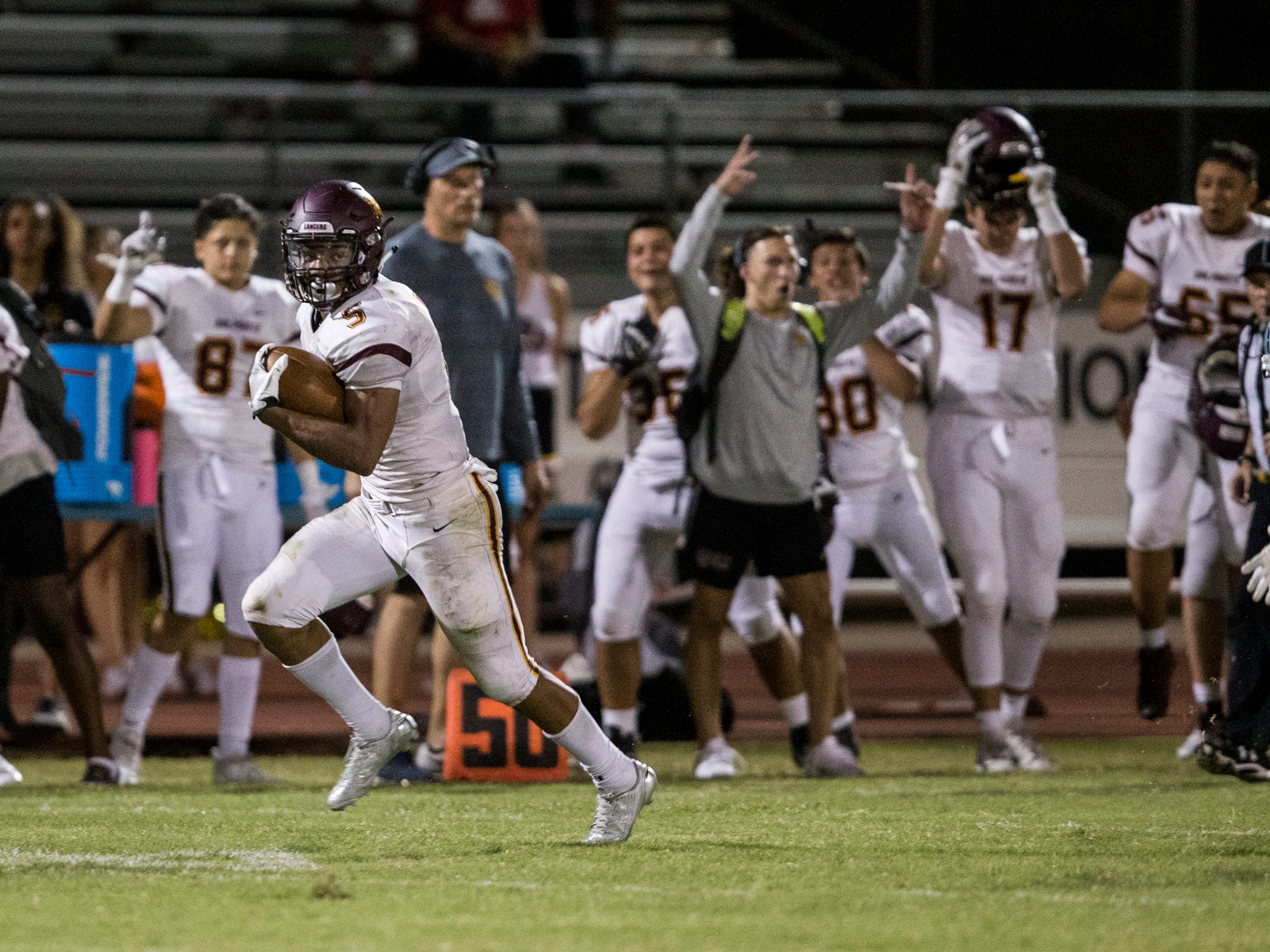 Salpointe's Bijan Robinson rushes for a touchdown against Cactus in the 2nd quarter on Friday, Sept. 14, 2018, at Cactus High School in Glendale, Ariz.
