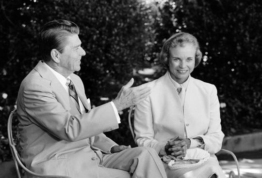 President Reagan presents his Supreme Court nominee Sandra Day O'Connor to members of the press, July 15, 1981, in the Rose Garden at the White House prior to the start of a meeting between the two which took place in the Oval Office.