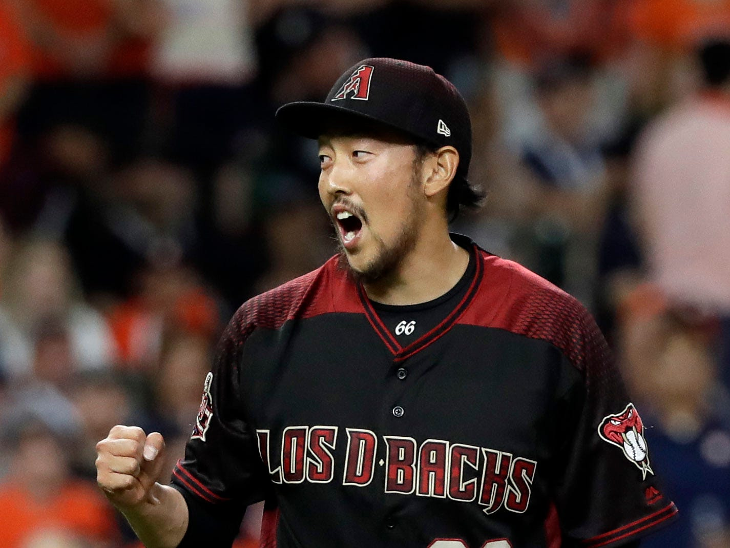 Arizona Diamondbacks relief pitcher Yoshihisa Hirano (66) reacts after the final out in the ninth inning of a baseball game against the Houston Astros Friday, Sept. 14, 2018, in Houston. The Diamondbacks won 4-2. (AP Photo/David J. Phillip)