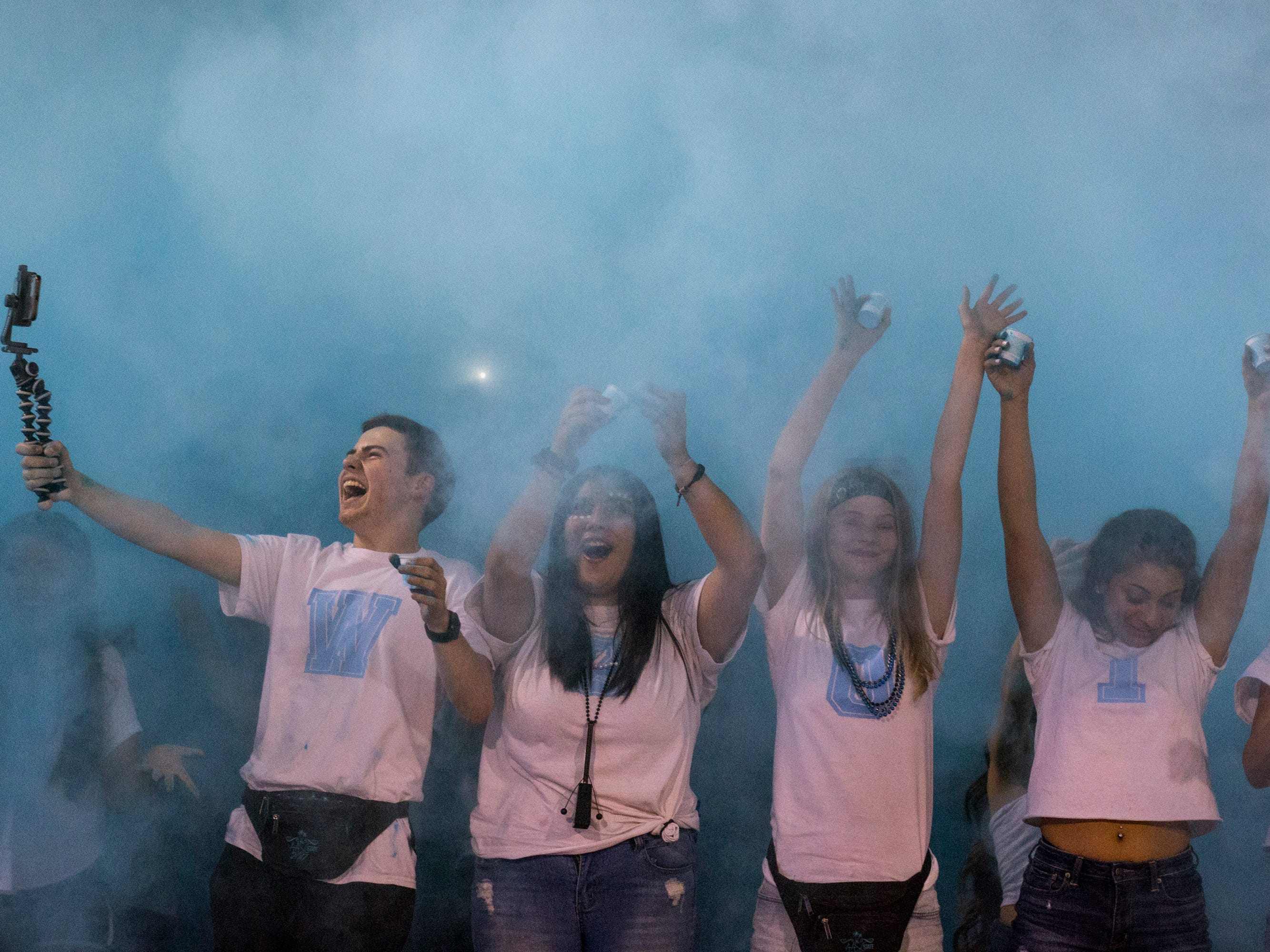 Cactus students throw up blue powder during the game against Salpointe on Friday, Sept. 14, 2018, at Cactus High School in Glendale, Ariz.#azhsfb