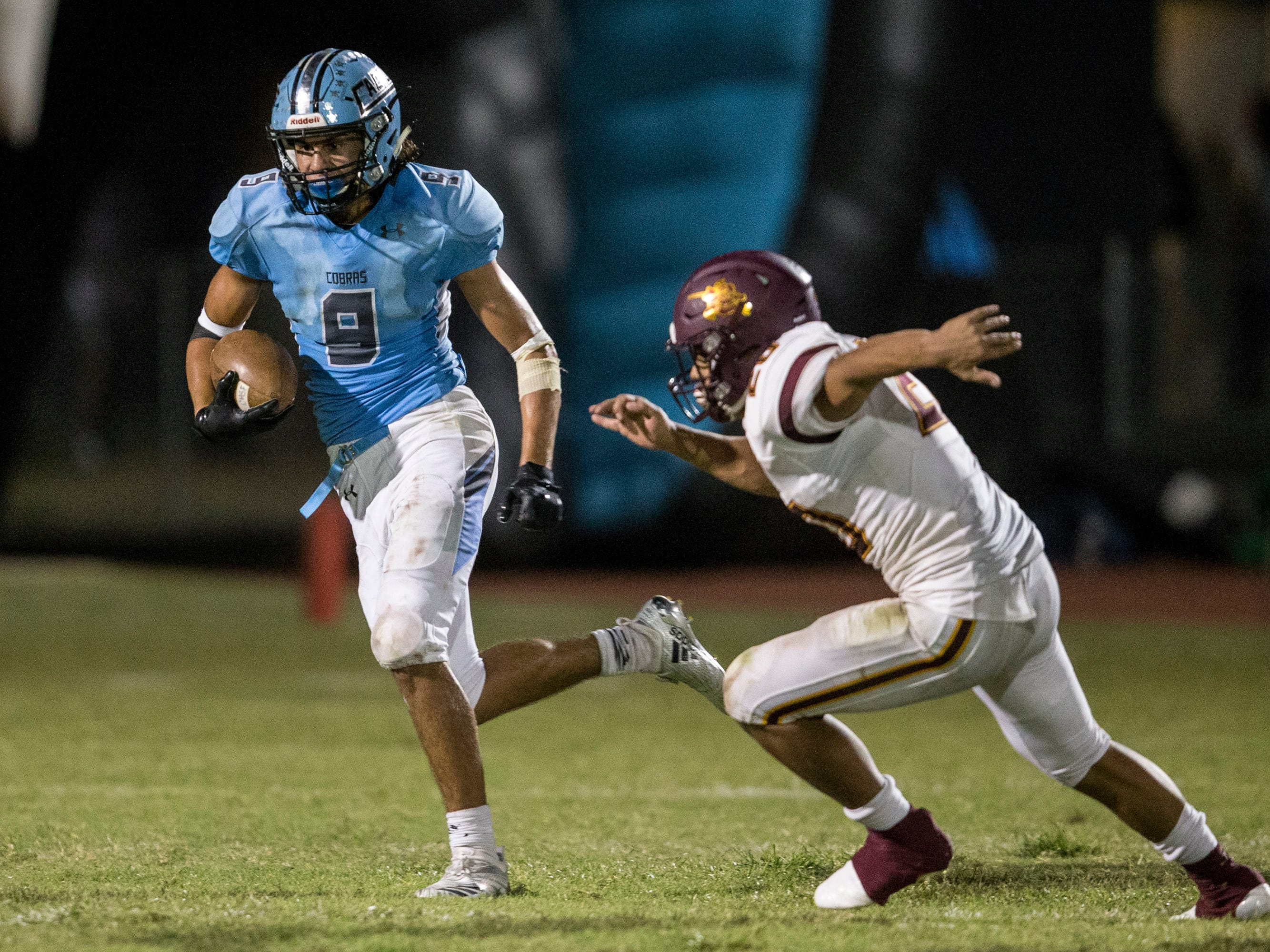 Cactus' Zach Cullop rushes against Salpointe in the 3rd quarter on Friday, Sept. 14, 2018, at Cactus High School in Glendale, Ariz.#azhsfb