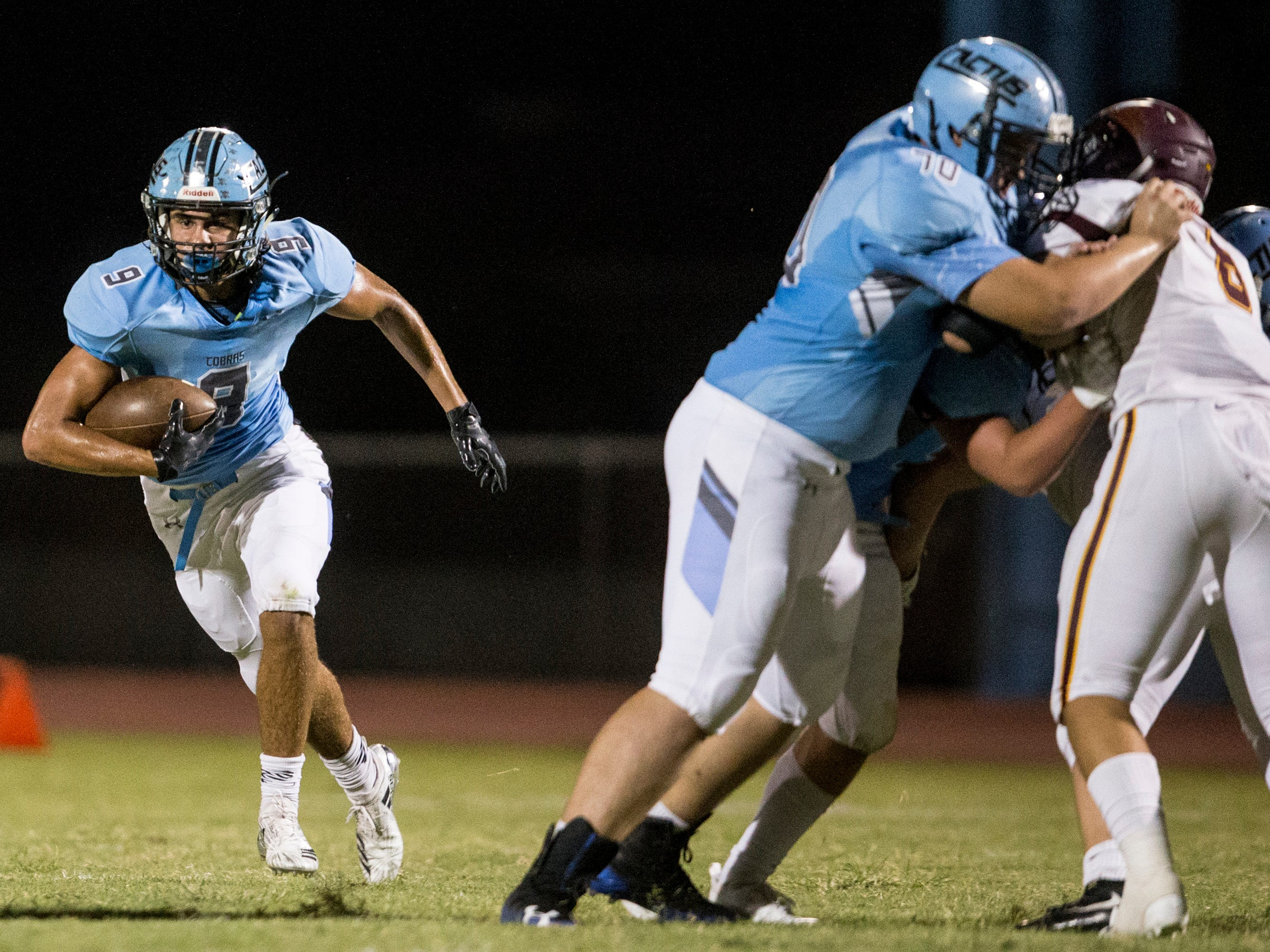 Cactus' Zaach Cullop rushes against Salpointe in the 1st quarter on Friday, Sept. 14, 2018, at Cactus High School in Glendale, Ariz.#azhsfb