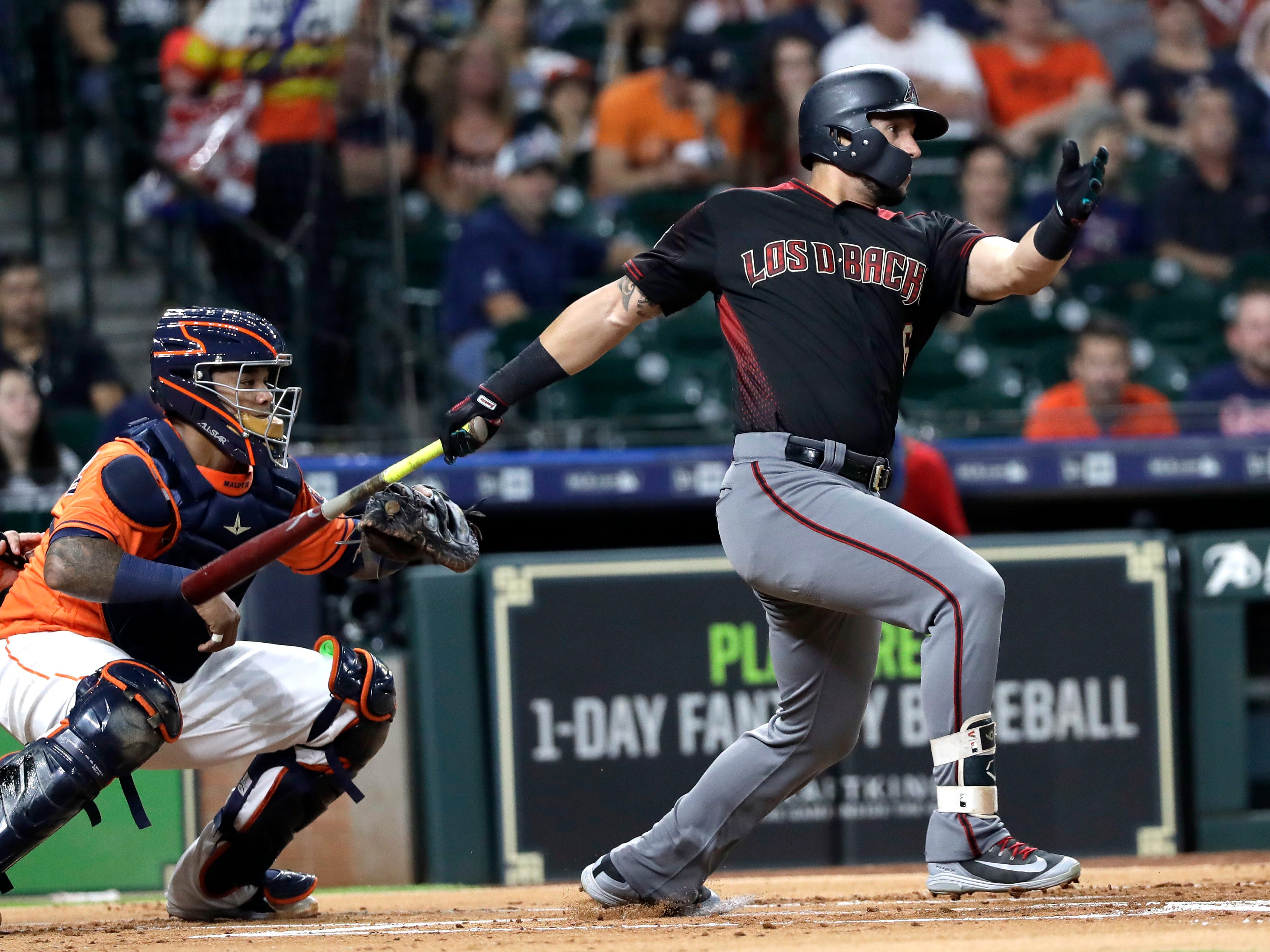 Arizona Diamondbacks' David Peralta, right, hits a two-run single as Houston Astros catcher Martin Maldonado reaches for the pitch during the first inning of a baseball game Friday, Sept. 14, 2018, in Houston.