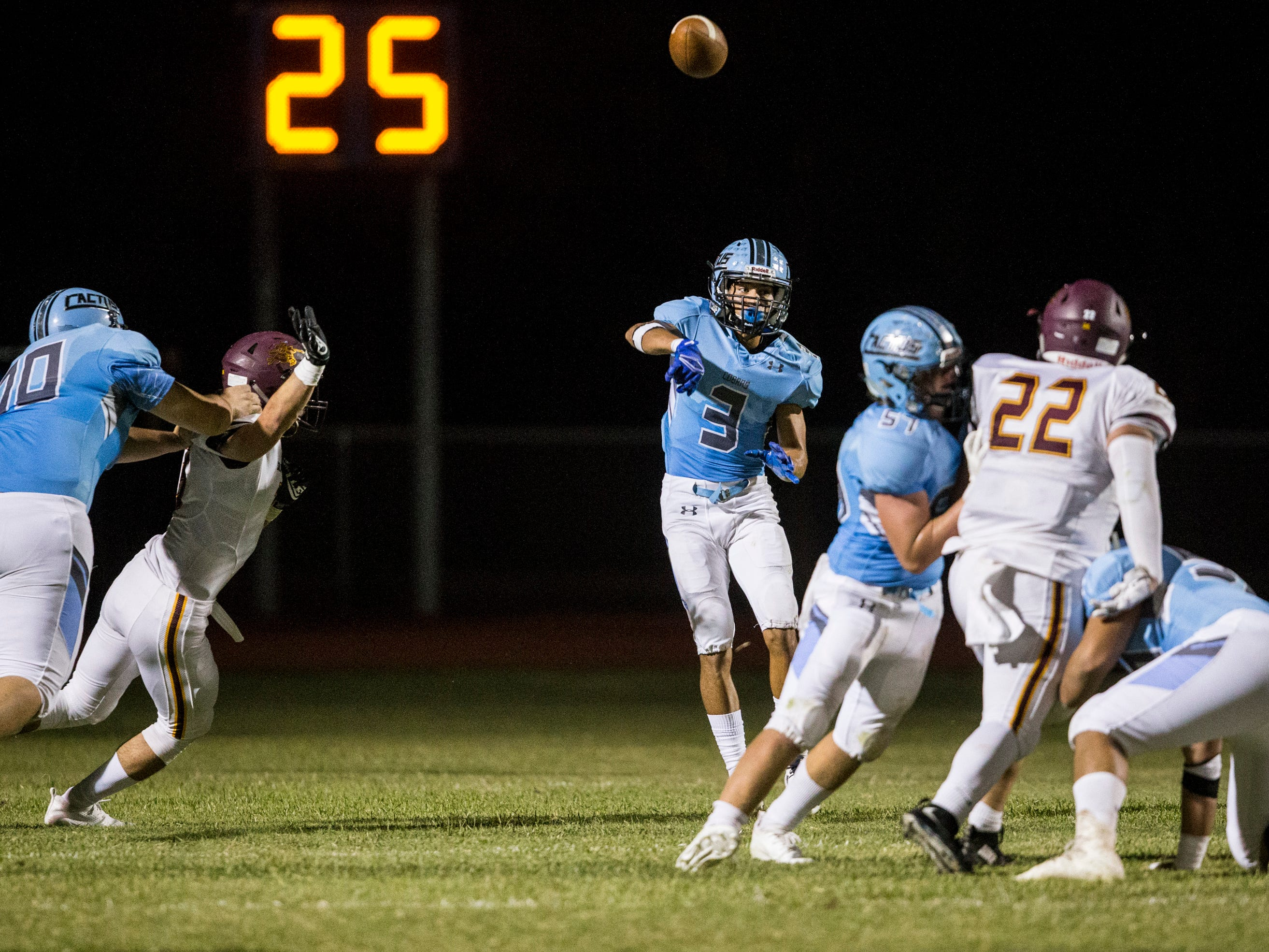 Cactus' Garrett Monroe throws against Salpointe in the 2nd quarter on Friday, Sept. 14, 2018, at Cactus High School in Glendale, Ariz.