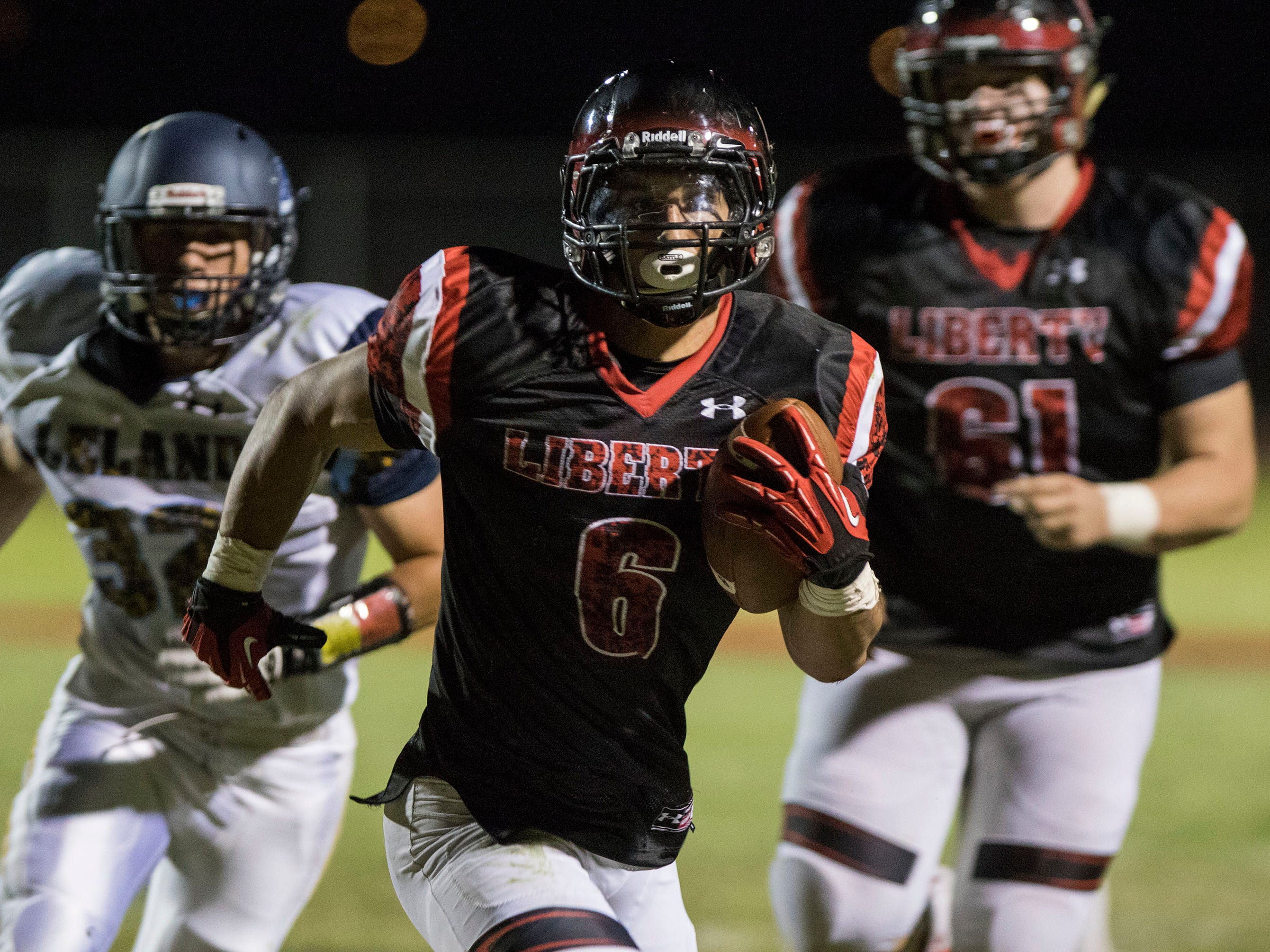 Liberty's Jett Kinsch finds running room against the Leland (CA) defense during their game in Peoria Friday, Sept.14, 2018. #azhsfb