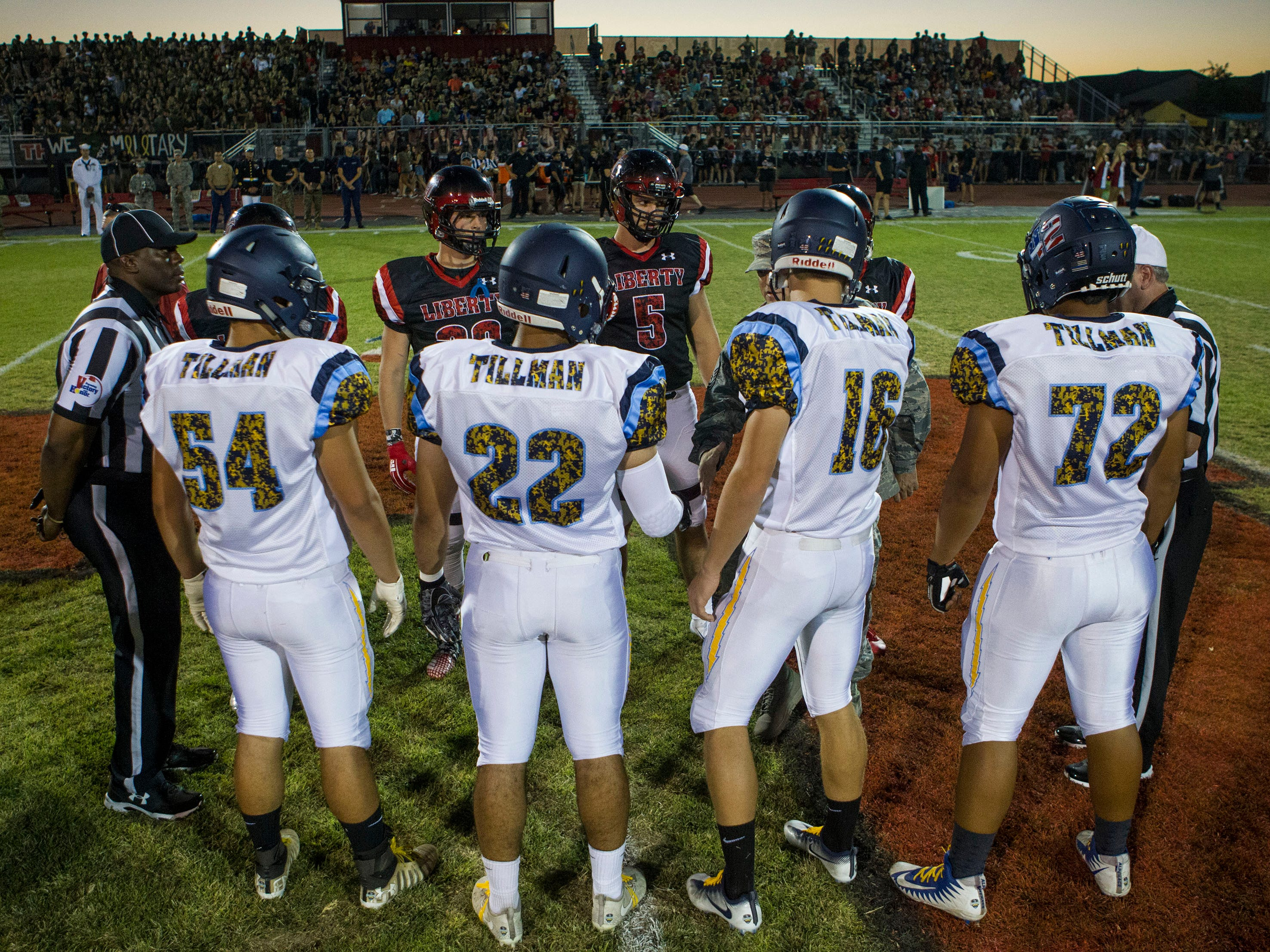 Liberty and Leland (CA) captains meet for the coin toss before their game in Peoria Friday, Sept.14, 2018. #azhsfb