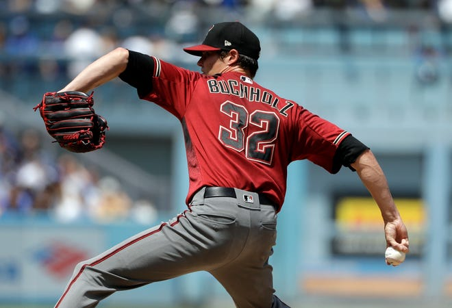 Arizona Diamondbacks starting pitcher Clay Buchholz throws to the Los Angeles Dodgers during the second inning of a baseball game Sunday, Sept. 2, 2018, in Los Angeles.