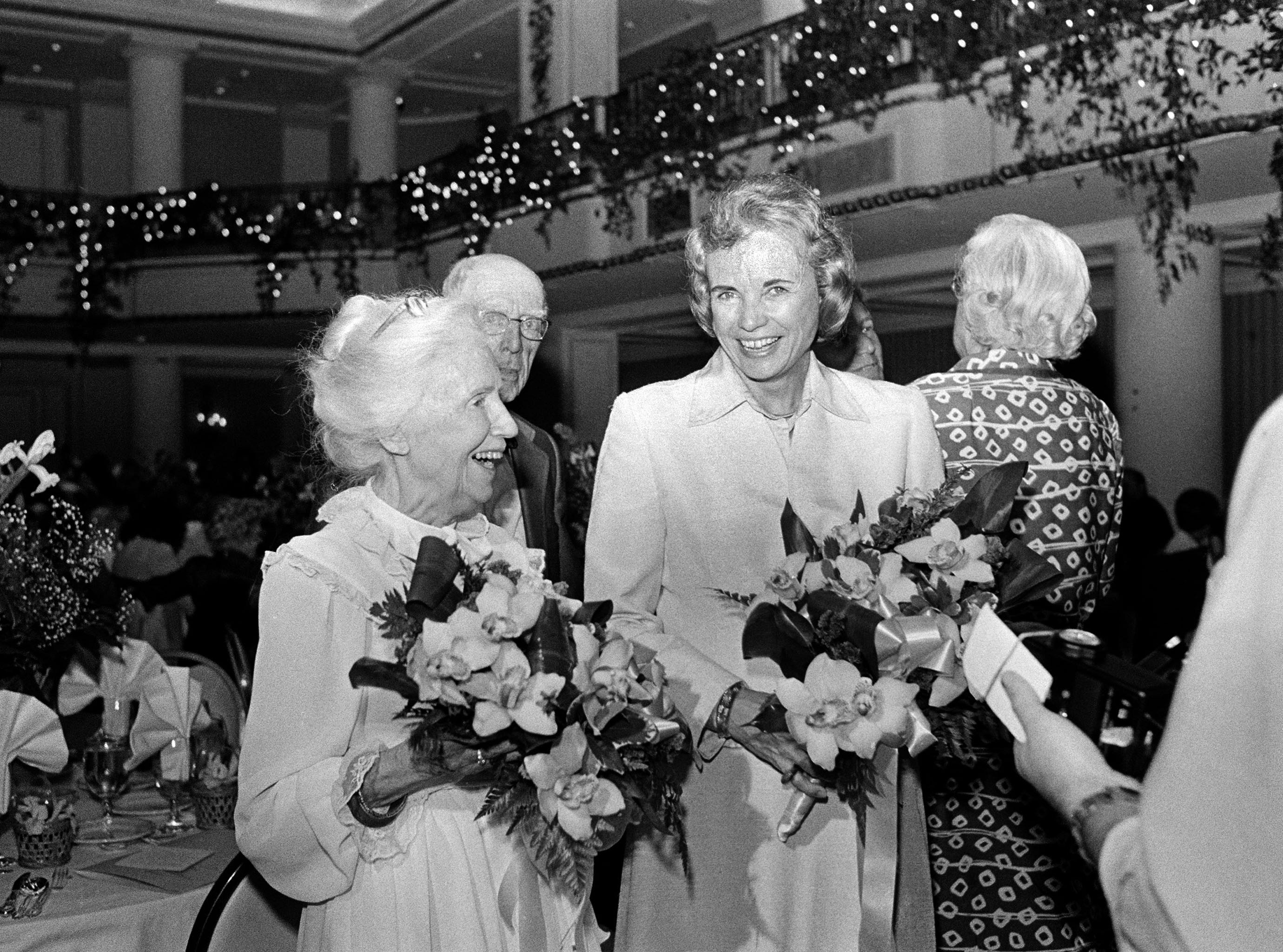 Supreme Court Justice Sandra Day O'Connor, right, and Margaret Kuhn, founder of the Gray Panthers, pose with bouquets of flowers after receiving awards at the 1982 Gimbel Awards luncheon in Philadelphia, May 5, 1982.