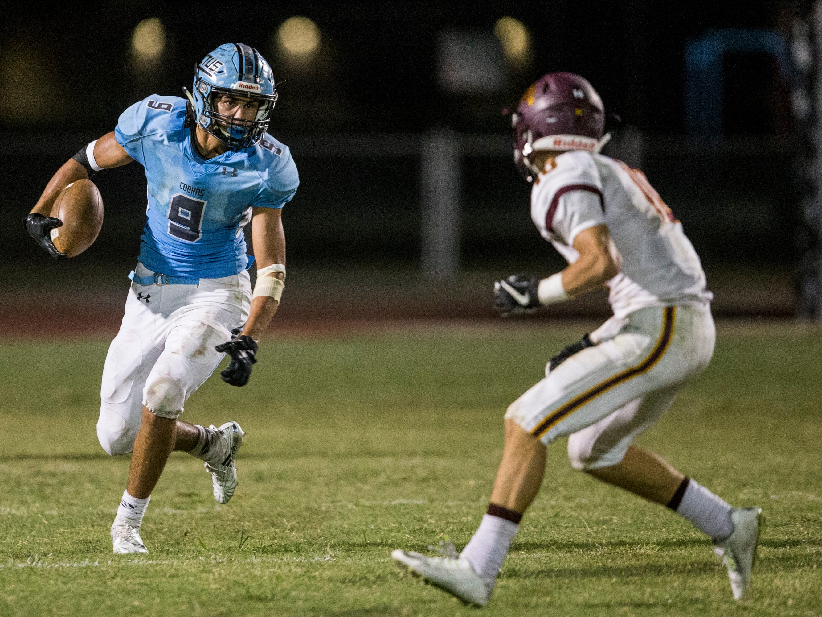Cactus' Zach Cullop rushes against Salpointe in the 3rd quarter on Friday, Sept. 14, 2018, at Cactus High School in Glendale, Ariz.