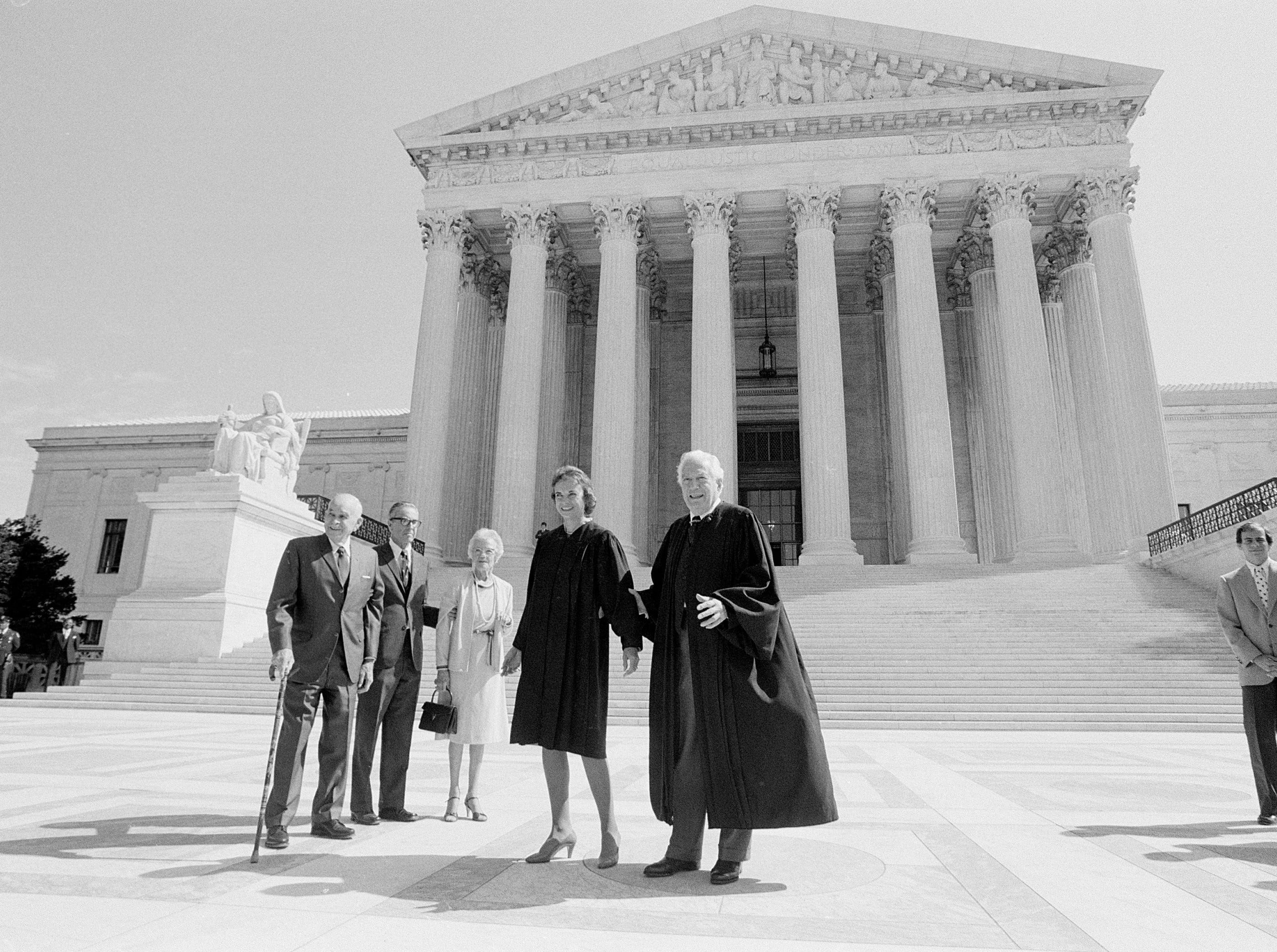 Sandra Day O'Connor poses for a photograph outside the U.S. Supreme Court in Washington, Sept. 25, 1981.  From left to right:  O'Connor's father Harry Day, her husband John J. O'Connor, her mother Ada Mae Day, and and Justice Warren Burger.