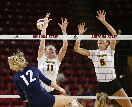 Arizona State University Shelbie Dobmeier (11) and teammate Carmen Unzue (5) attempt to block a ball by Northern Arizona University Kaylie Jorgenson (12) during a women's volleyball match at Wells Fargo Arena in Tempe on September 14, 2018.