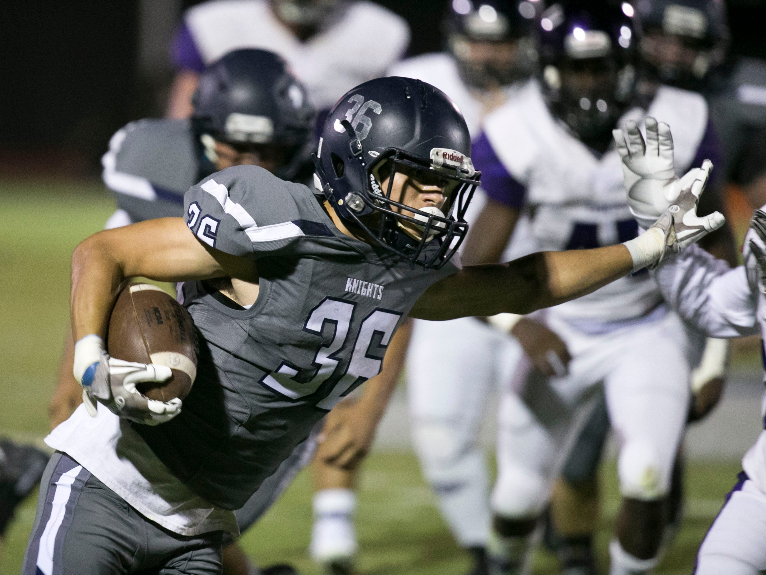 Higley High running back Noah Montano carries the ball  against Millennium High during the second quarter of the high school football game at Higley High in Gilbert on Friday evening, September 14, 2018.
