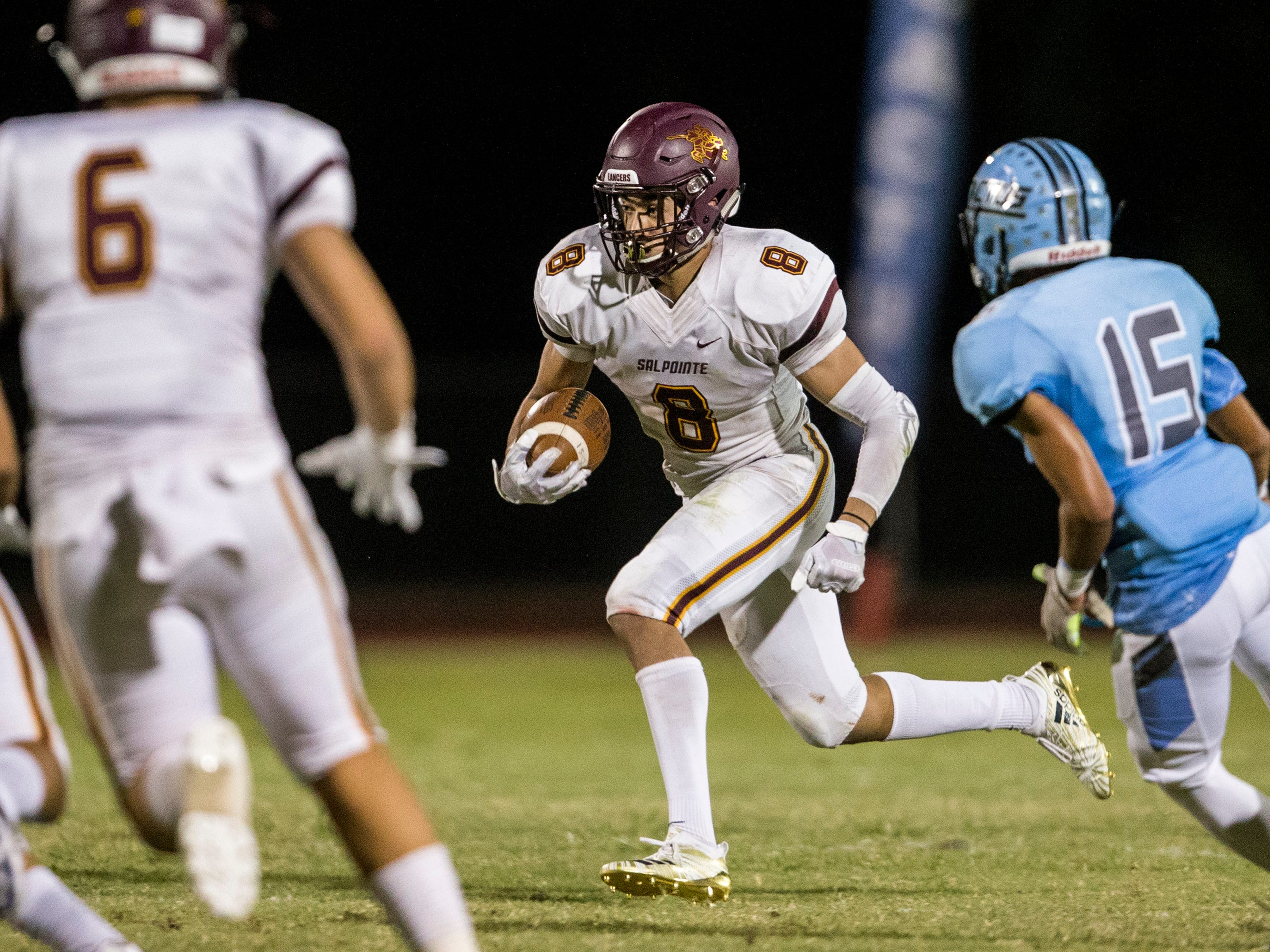 Salpointe's Lathan Ransom rushes against Cactus in the 2nd quarter on Friday, Sept. 14, 2018, at Cactus High School in Glendale, Ariz.