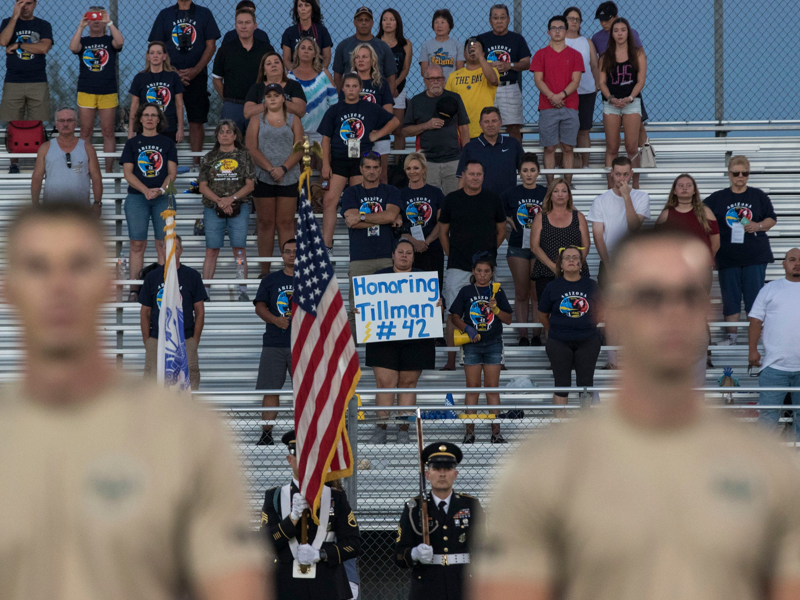 Fans from Leland High School stand and honor their alumnus Pat Tillman before their game with Liberty in Peoria Friday, Sept.14, 2018. #azhsfb