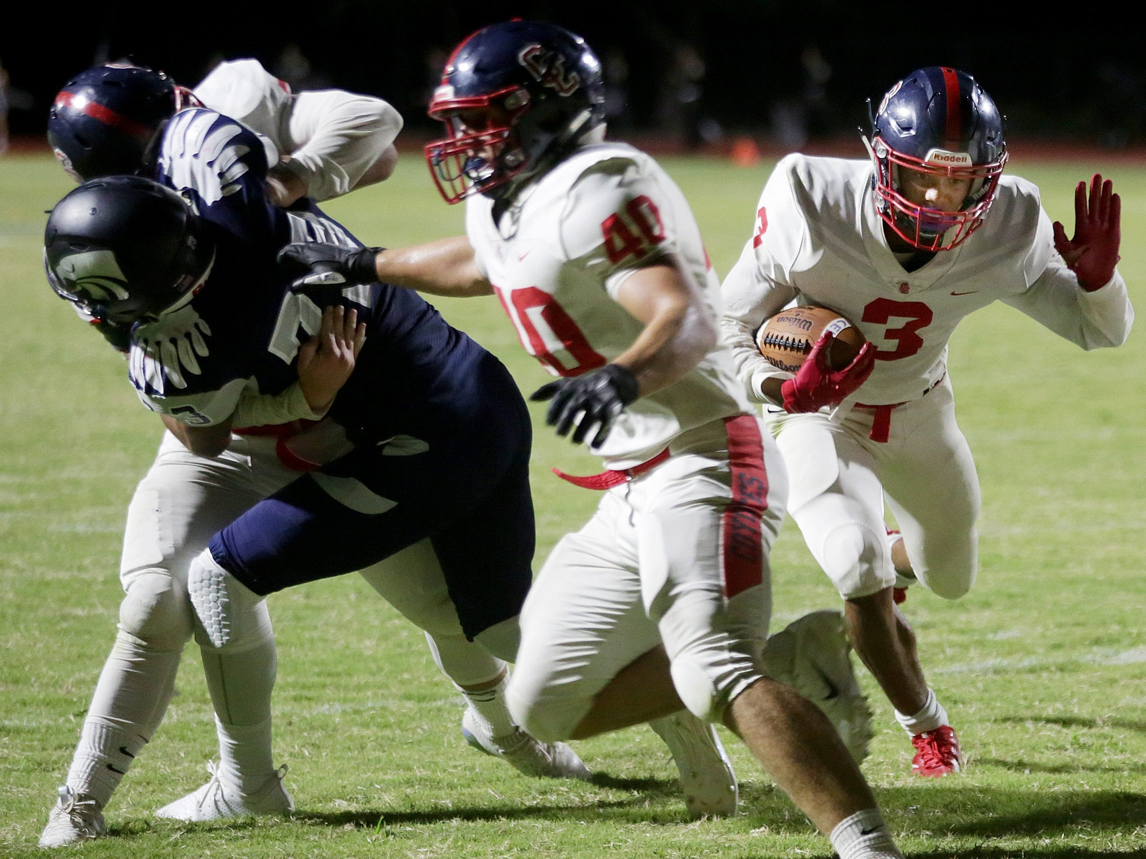The offensive line punches open a huge hole for Peoria Centennial's Jaydin Young (3) to score during the second quarter of the Ironwood Ridge vs. Peoria Centennial high school football game at Ironwood Ridge High School, 2475 W. Naranja Drive, on Sept. 14, 2018, in Oro Valley, Ariz. Centennial won 55-7.