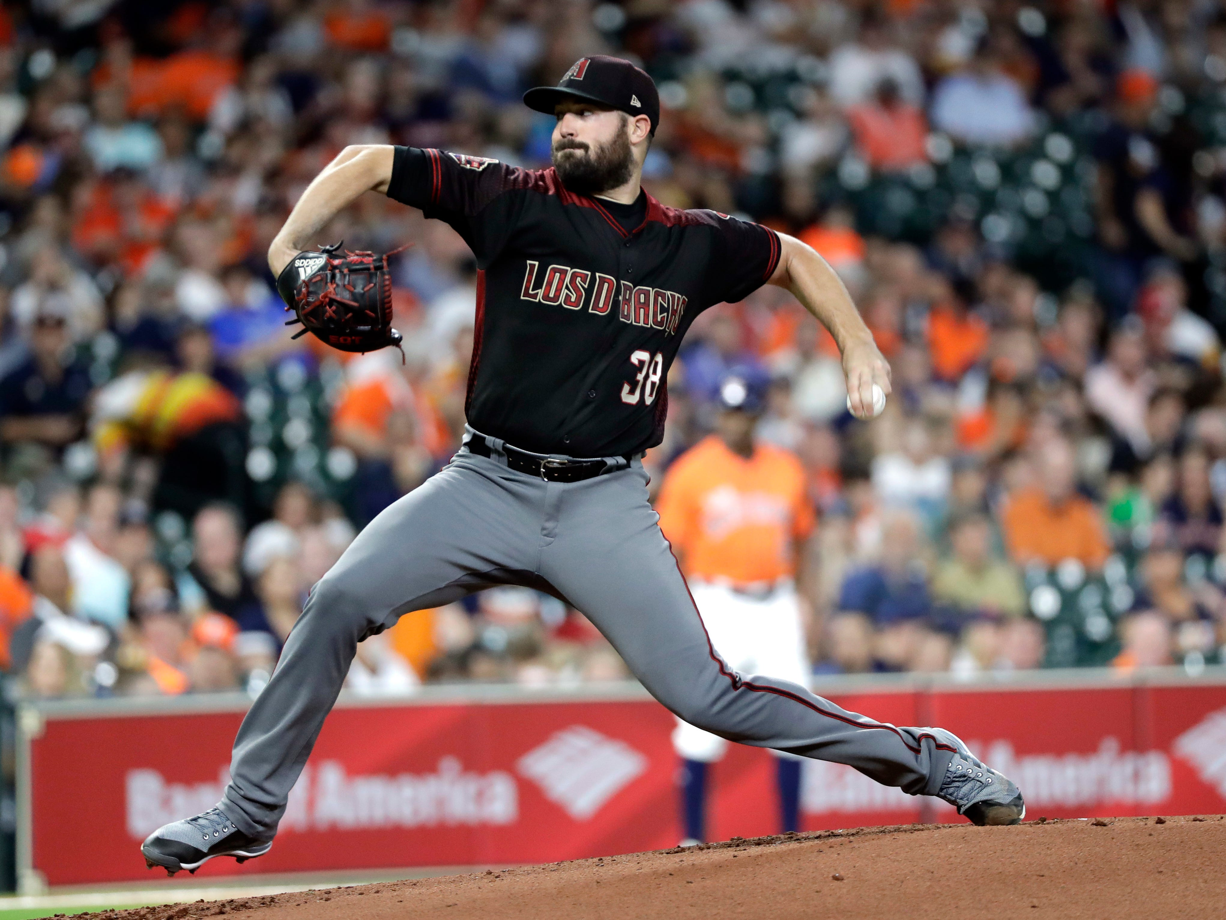 Arizona Diamondbacks starting pitcher Robbie Ray throws against the Houston Astros during the first inning of a baseball game Friday, Sept. 14, 2018, in Houston.