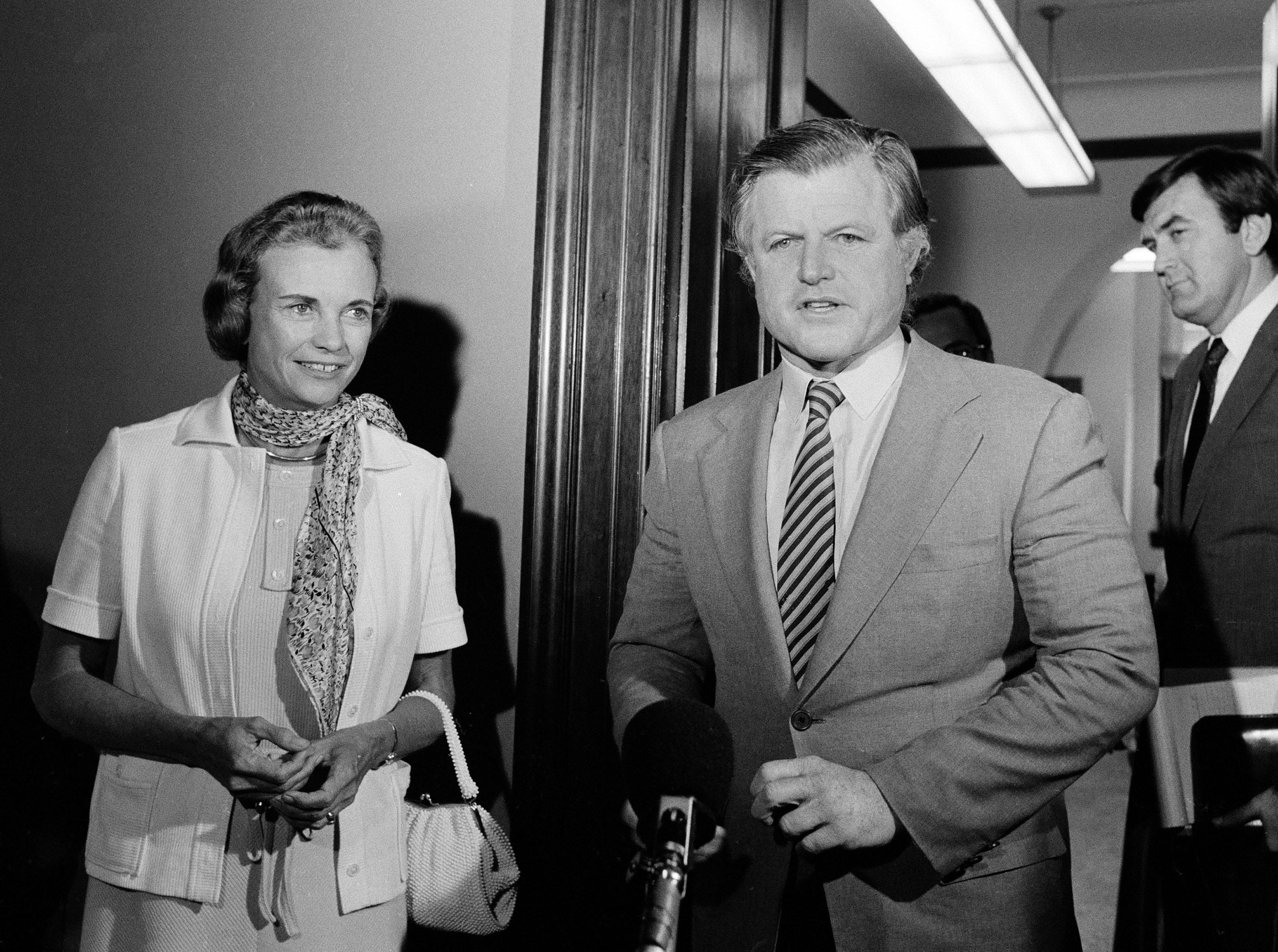 Supreme Court nominee Sandra Day O'Connor and Sen. Edward Kennedy, D-Mass., make a statement to reporters, July 17, 1981, on Capitol Hill.