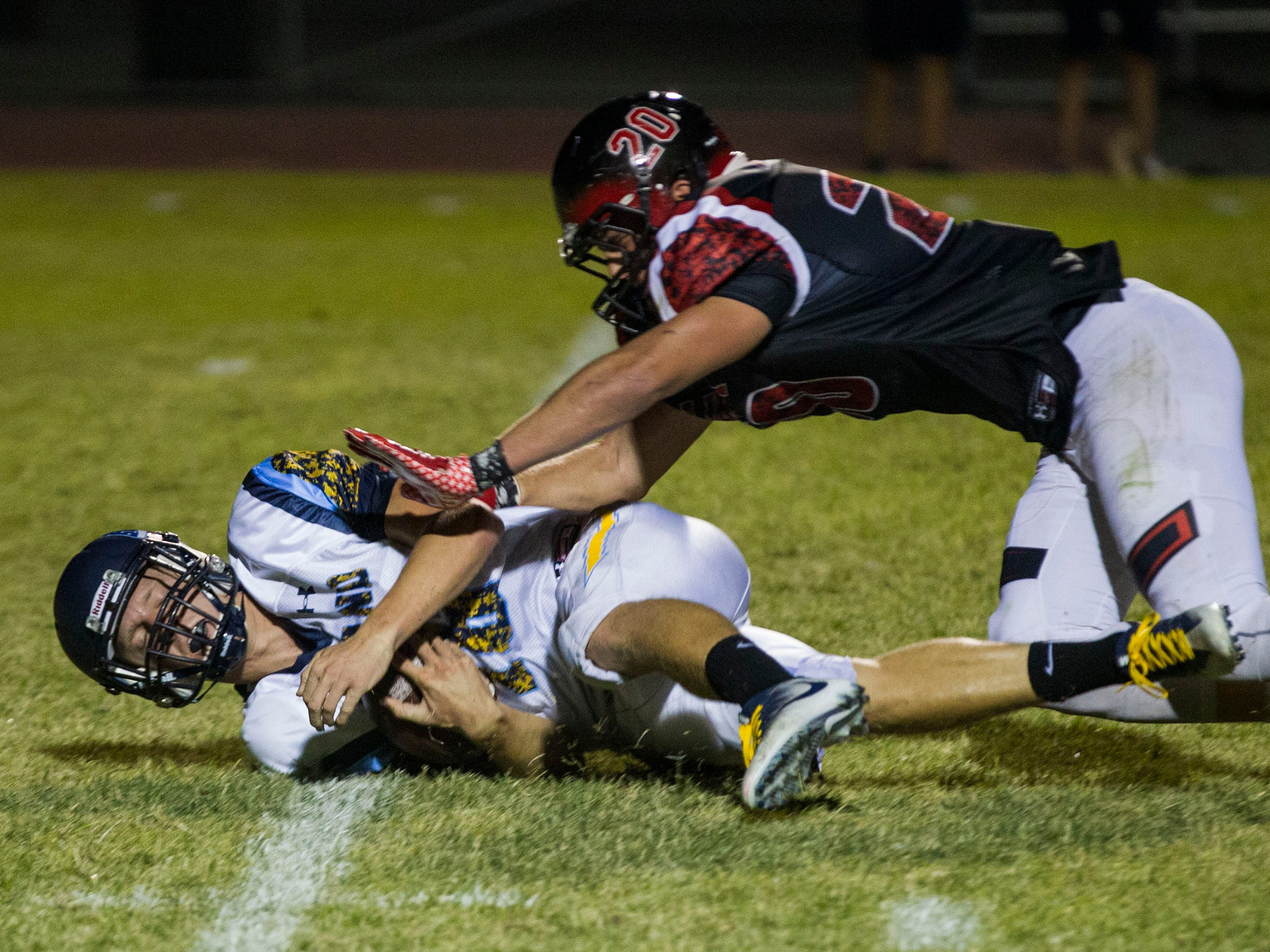 Leland quarterback Carson Yates gets sacked by Liberty's Ryan Puskas during their game in Peoria Friday, Sept.14, 2018. #azhsfb