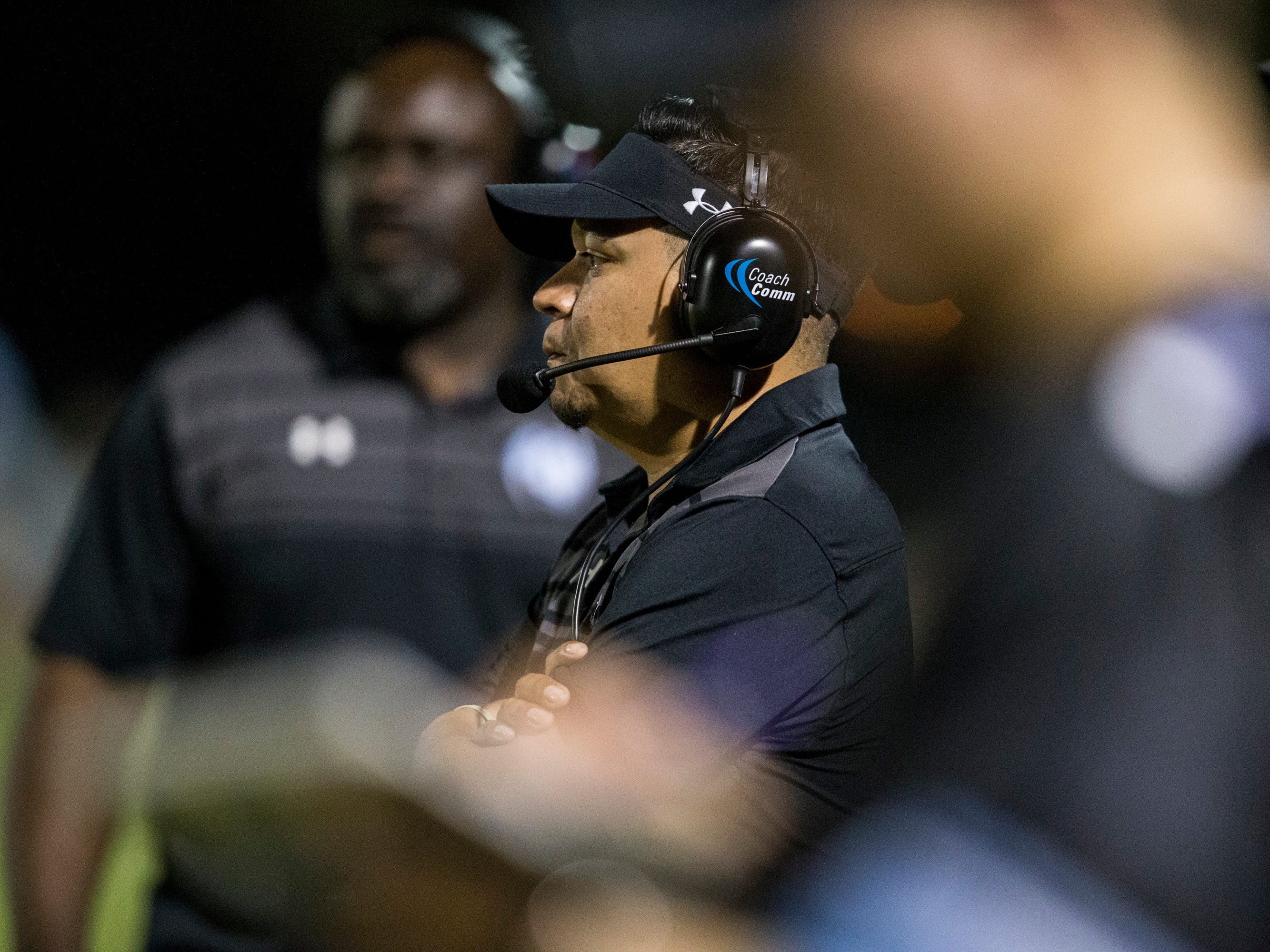 Cactus head coach Joseph Ortiz watches the game against Salpointe on Friday, Sept. 14, 2018, at Cactus High School in Glendale, Ariz.