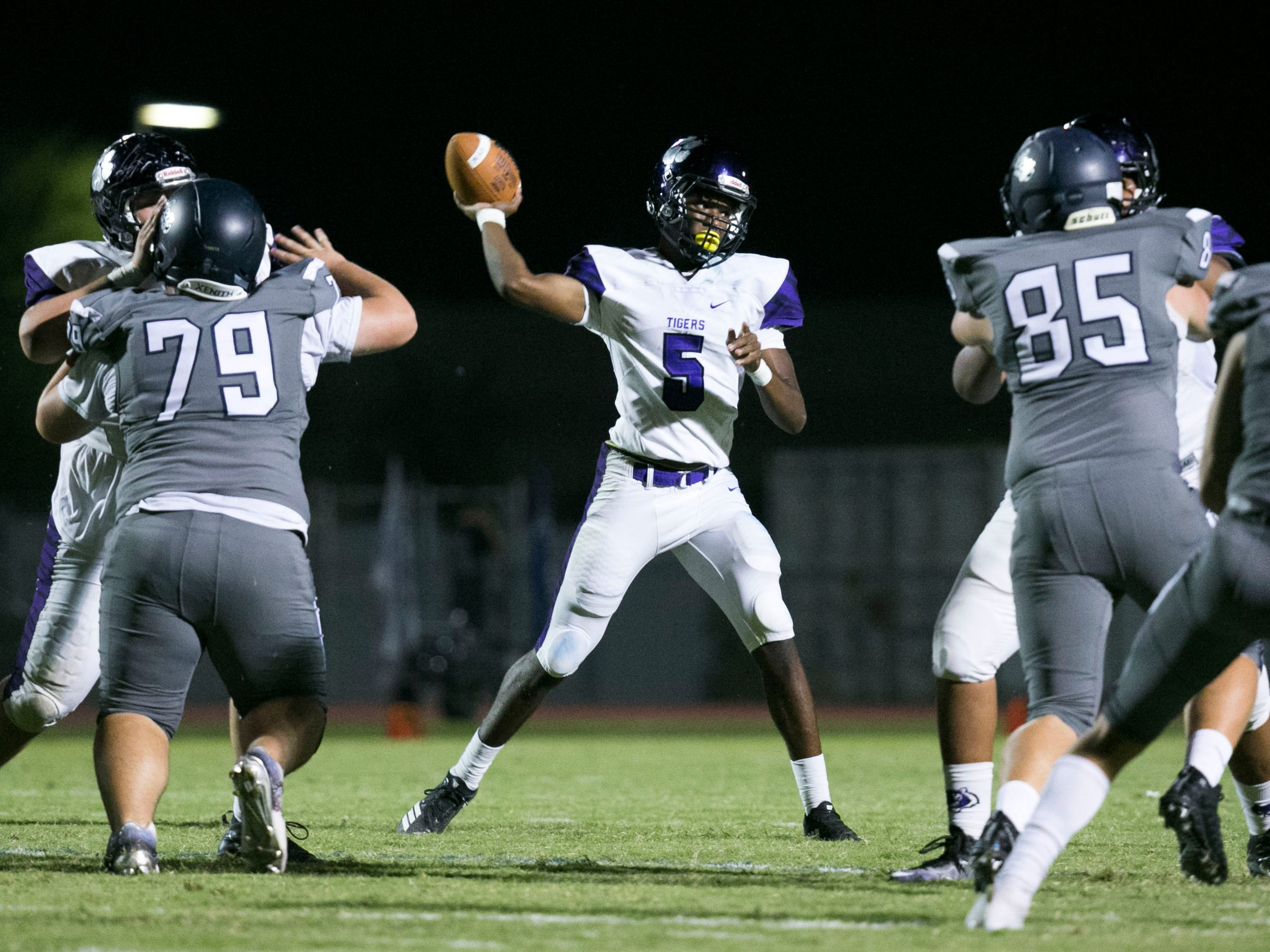 Millennium High quarterback Zareq Brown passes against Higley High during the fourth quarter of the high school football game at Higley High in Gilbert on Friday evening, September 14, 2018.