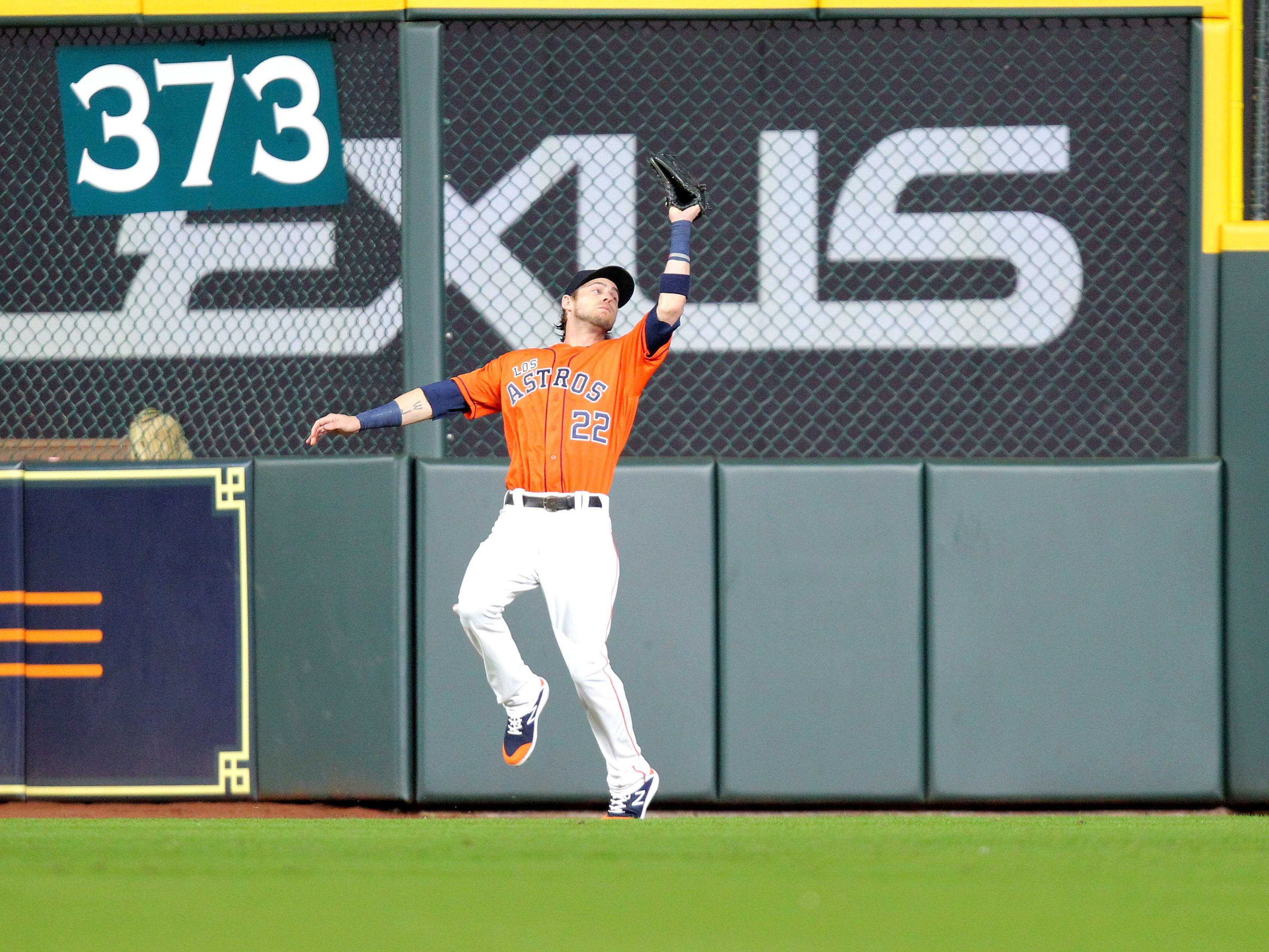 Sep 14, 2018: Houston Astros right fielder Josh Reddick (22) catches a fly ball for an out to retire the side against the Arizona Diamondbacks during the first inning at Minute Maid Park.