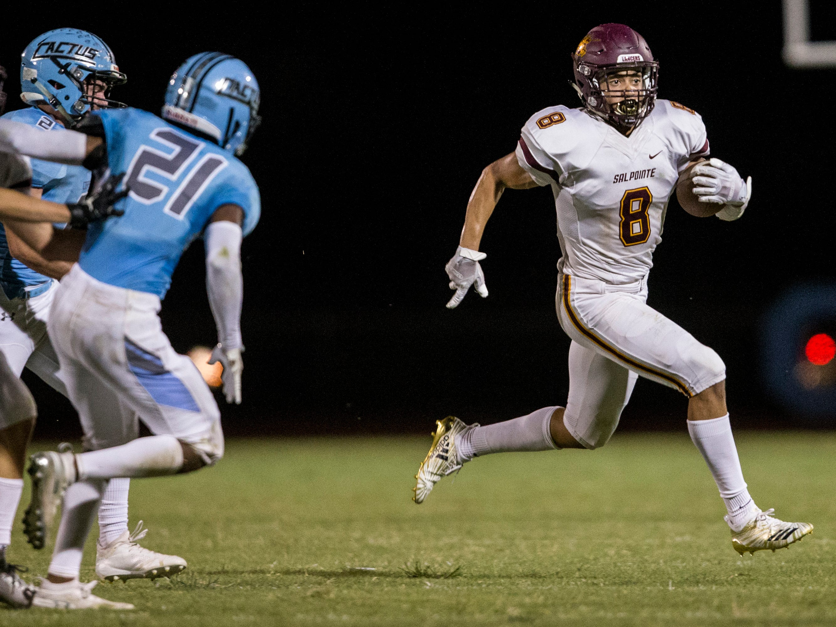 Salpointe's Lathan Ransom rushes against Cactus in the 1st quarter on Friday, Sept. 14, 2018, at Cactus High School in Glendale, Ariz.