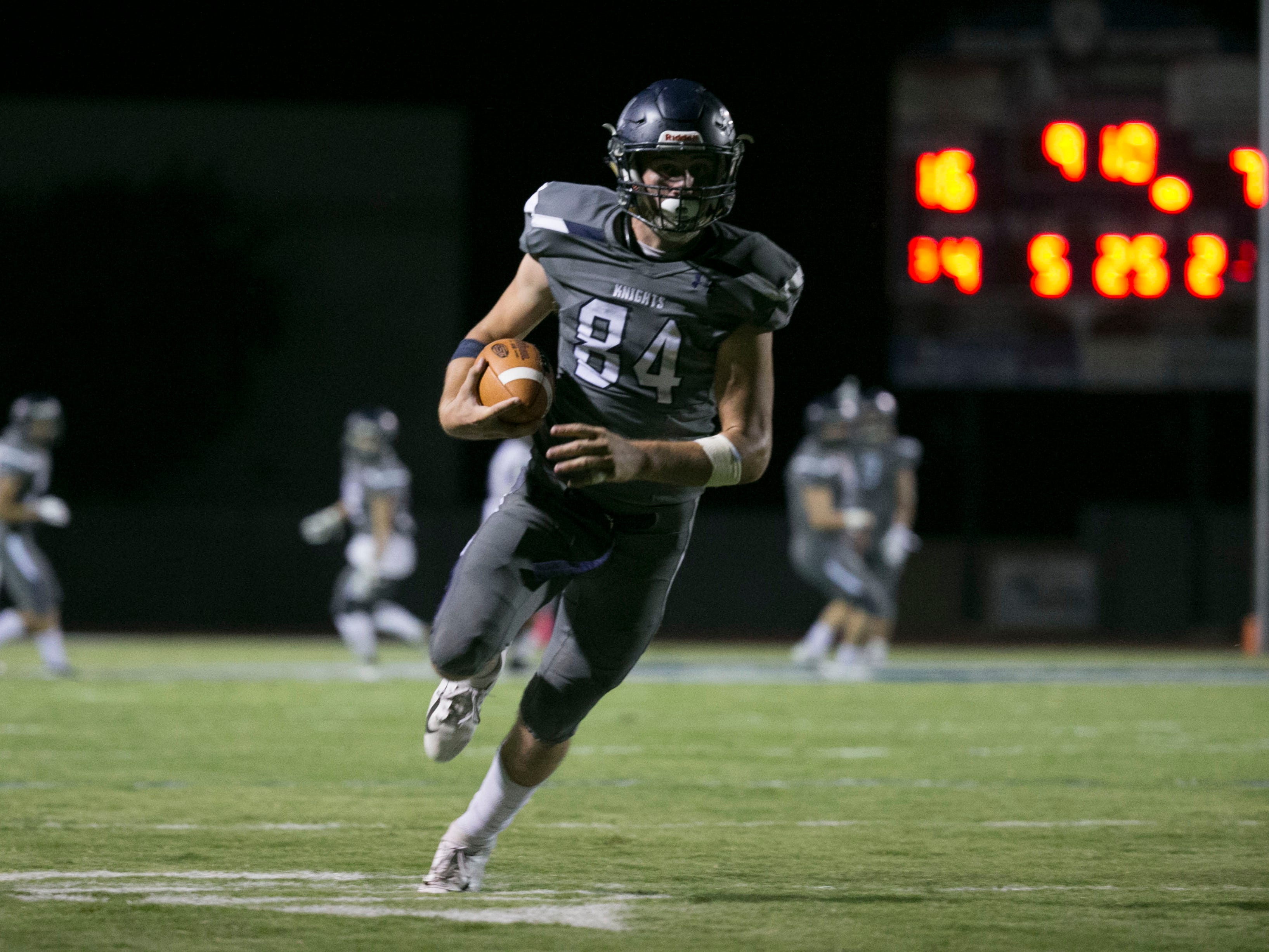 Higley High's Logan Maxwell scores a touchdown after blocking a punt on Millennium High during the second quarter of the high school football game at Higley High in Gilbert on Friday evening, September 14, 2018.