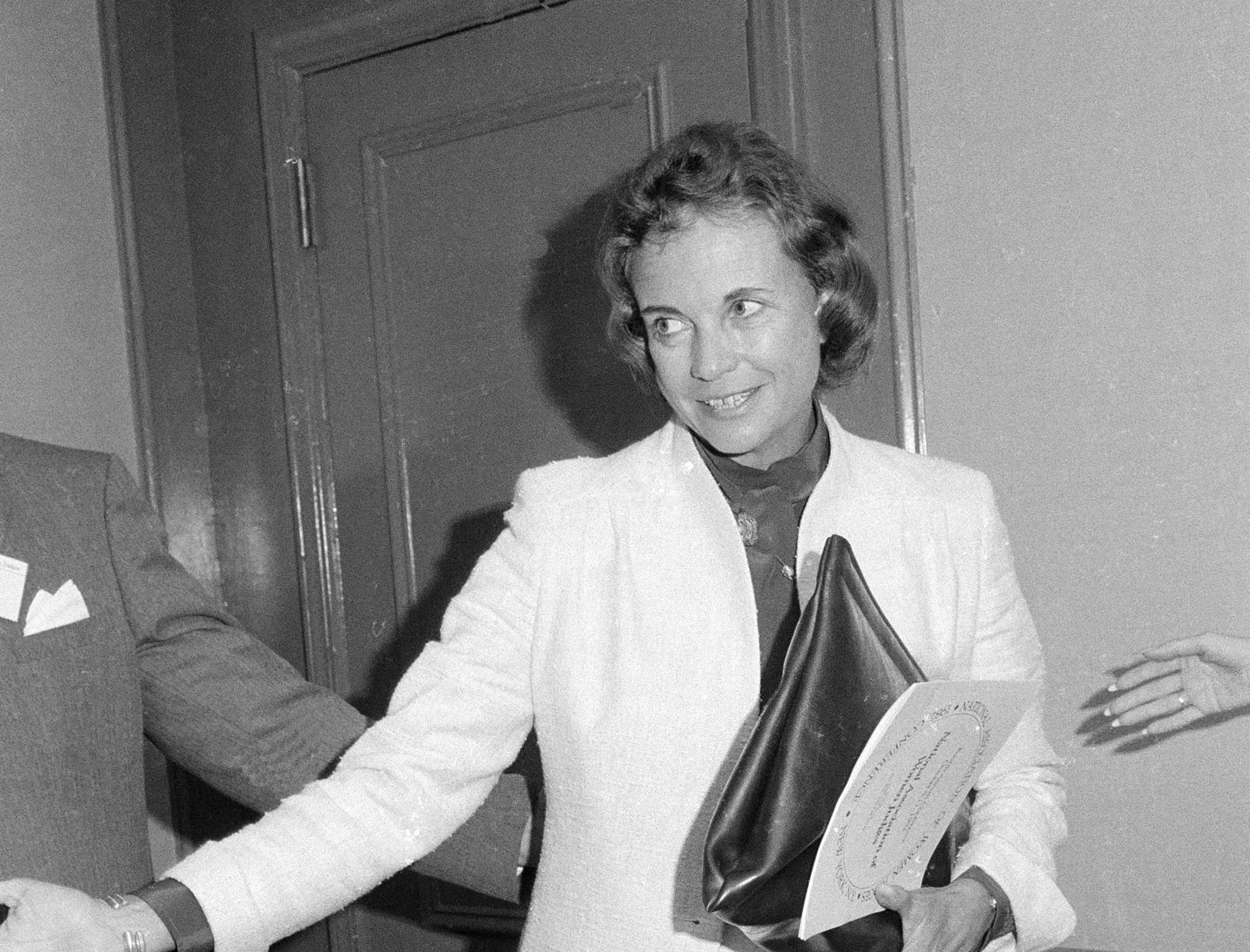 U.S. Supreme Court Justice Sandra Day O'Connor has her hands full as she arrives at the Fourth Annual National Association of Women Judges conference in New York, Oct. 9, 1982.