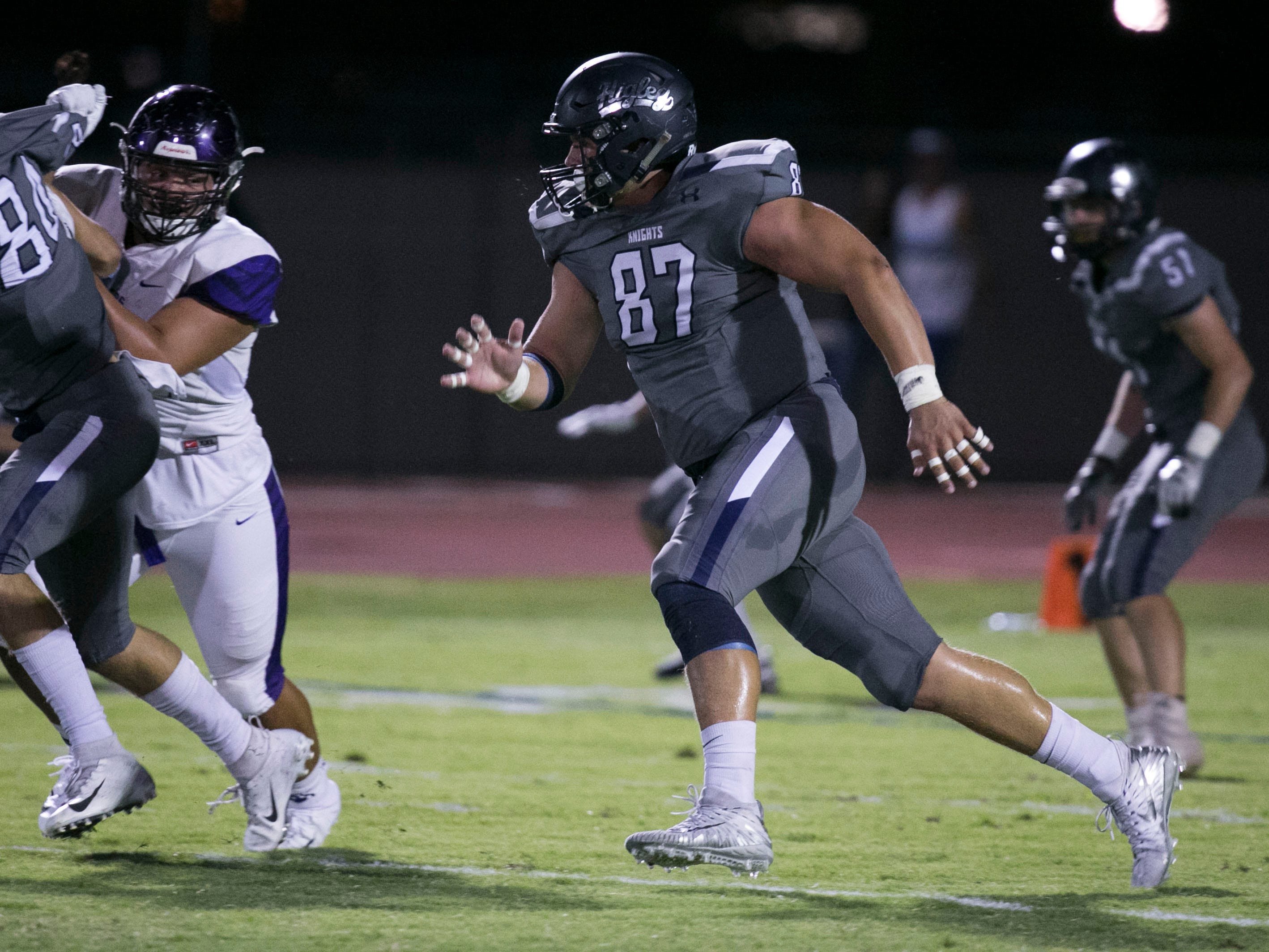 Higley High defensive lineman Ty Robinson pursues  during the first quarter of the high school football game against Millennium High at Higley High in Gilbert on Friday evening, September 14, 2018.
