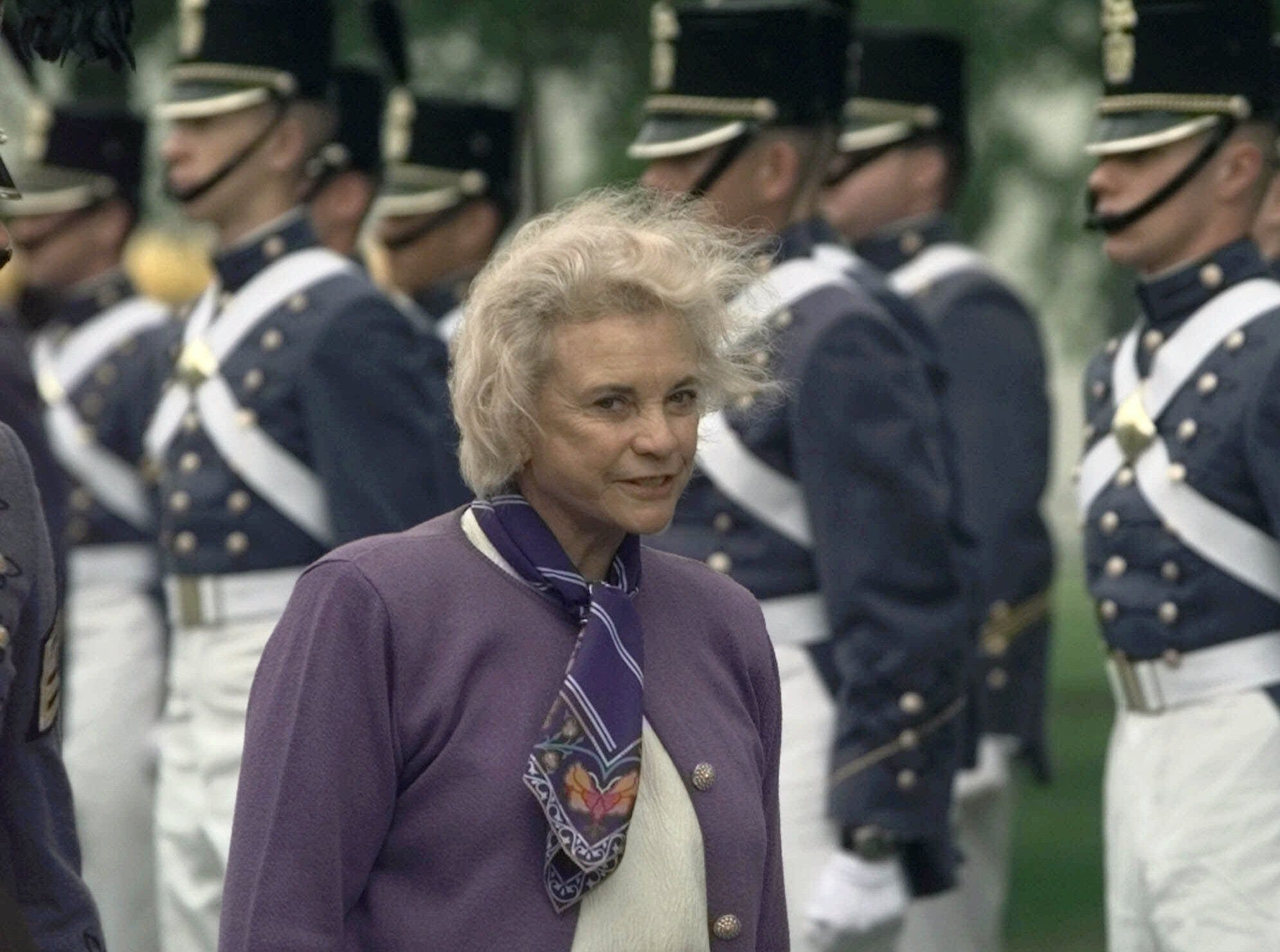 U.S. Supreme Court Justice Sandra Day O'Connor walks pass an honor guard on the way to address the The Citadel Corps of Cadets Tuesday April 4, 2000, at the military college in Charleston, S.C.