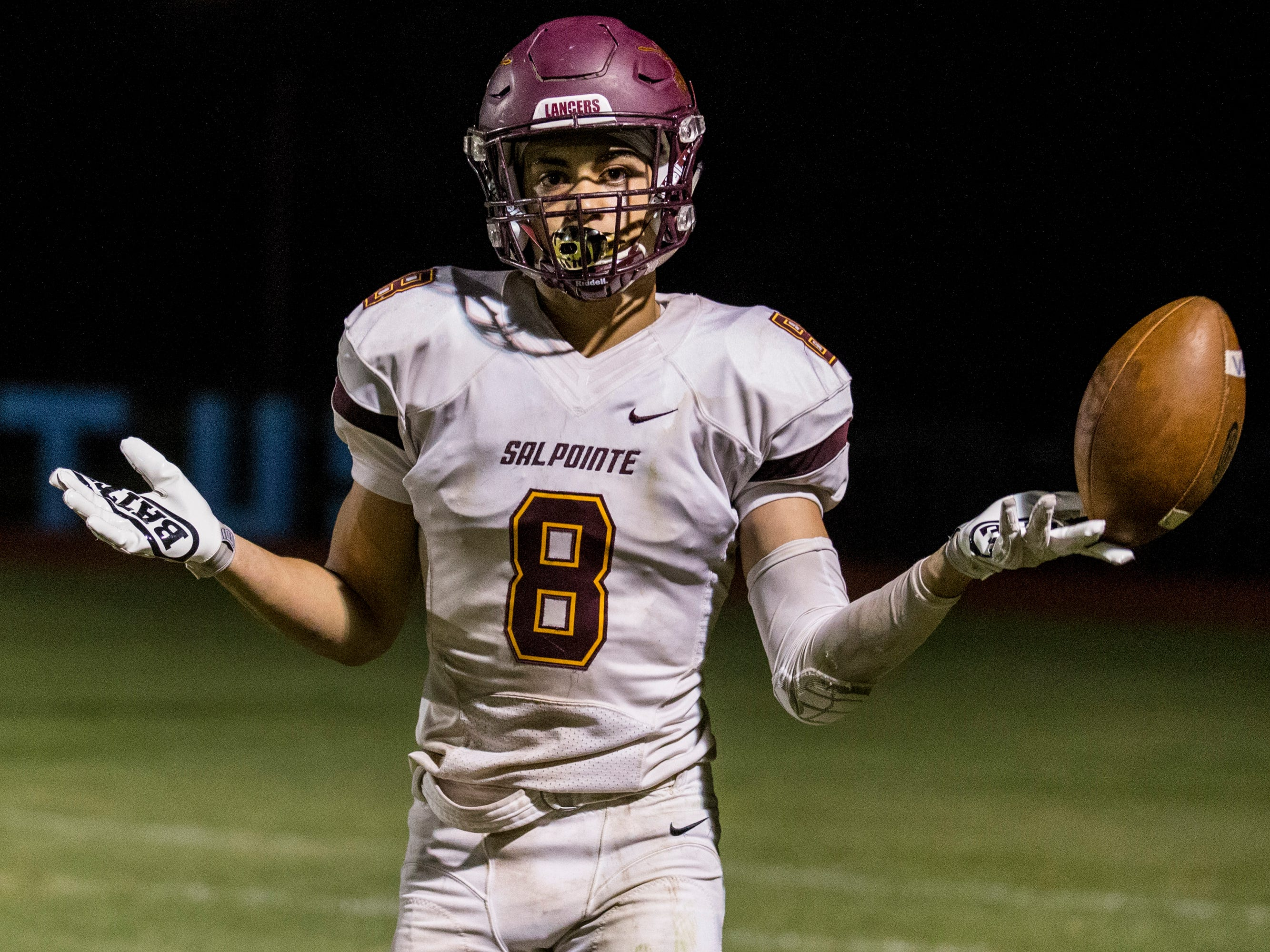 Salpointe's Lathan Ransom celebrates after a touchdown reception against in the 4th quarter on Friday, Sept. 14, 2018, at Cactus High School in Glendale, Ariz.#azhsfb