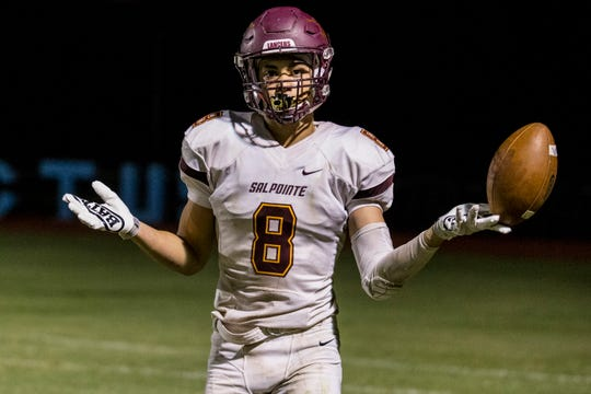 Salpointe's Lathan Ransom celebrates after a touchdown reception against in the 4th quarter on Friday, Sept. 14, 2018, at Cactus High School in Glendale, Ariz.