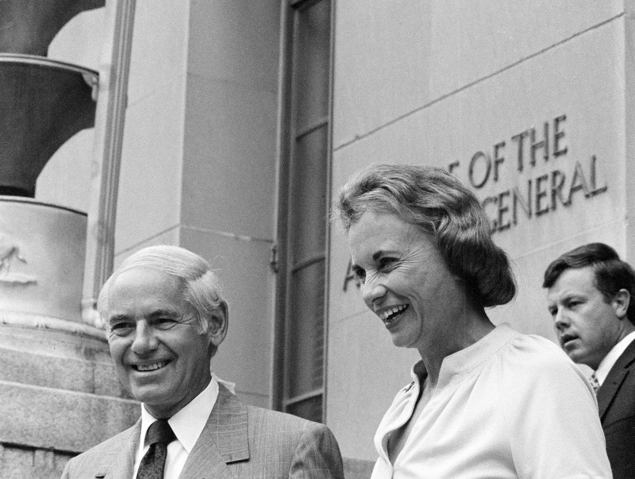 Supreme Court nominee Sandra Day O'Connor is escorted by Attorney General William French Smith toward a waiting car as she departs the Department of Justice in Washington on Sept. 4, 1981.