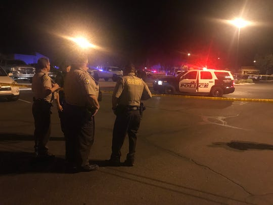 Mesa police officers and Maricopa County sheriff's deputies were at the scene of a shooting involving an officer Friday night near Main and 74th streets.