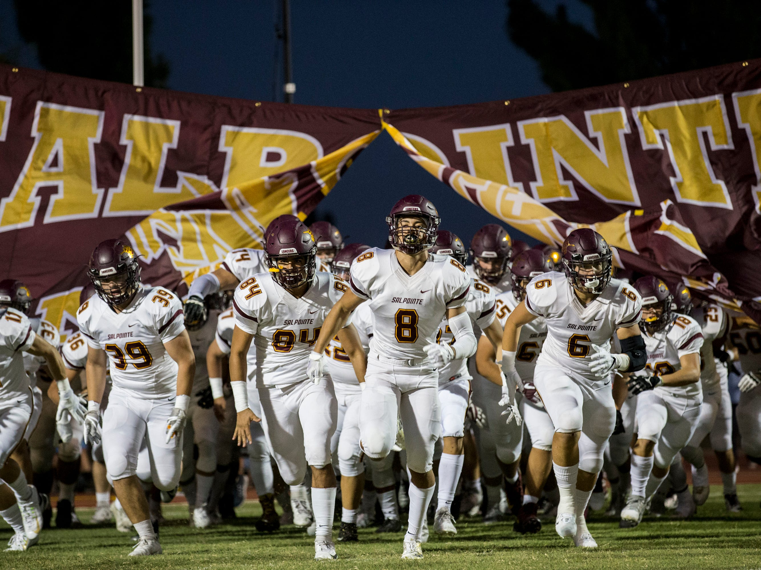 Salpointe takes the field before the game against Cactus on Friday, Sept. 14, 2018, at Cactus High School in Glendale, Ariz.
