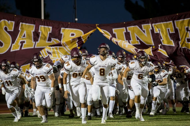 Salpointe takes the field before the game against Cactus on Friday, Sept. 14, 2018, at Cactus High School in Glendale, Ariz.#azhsfb