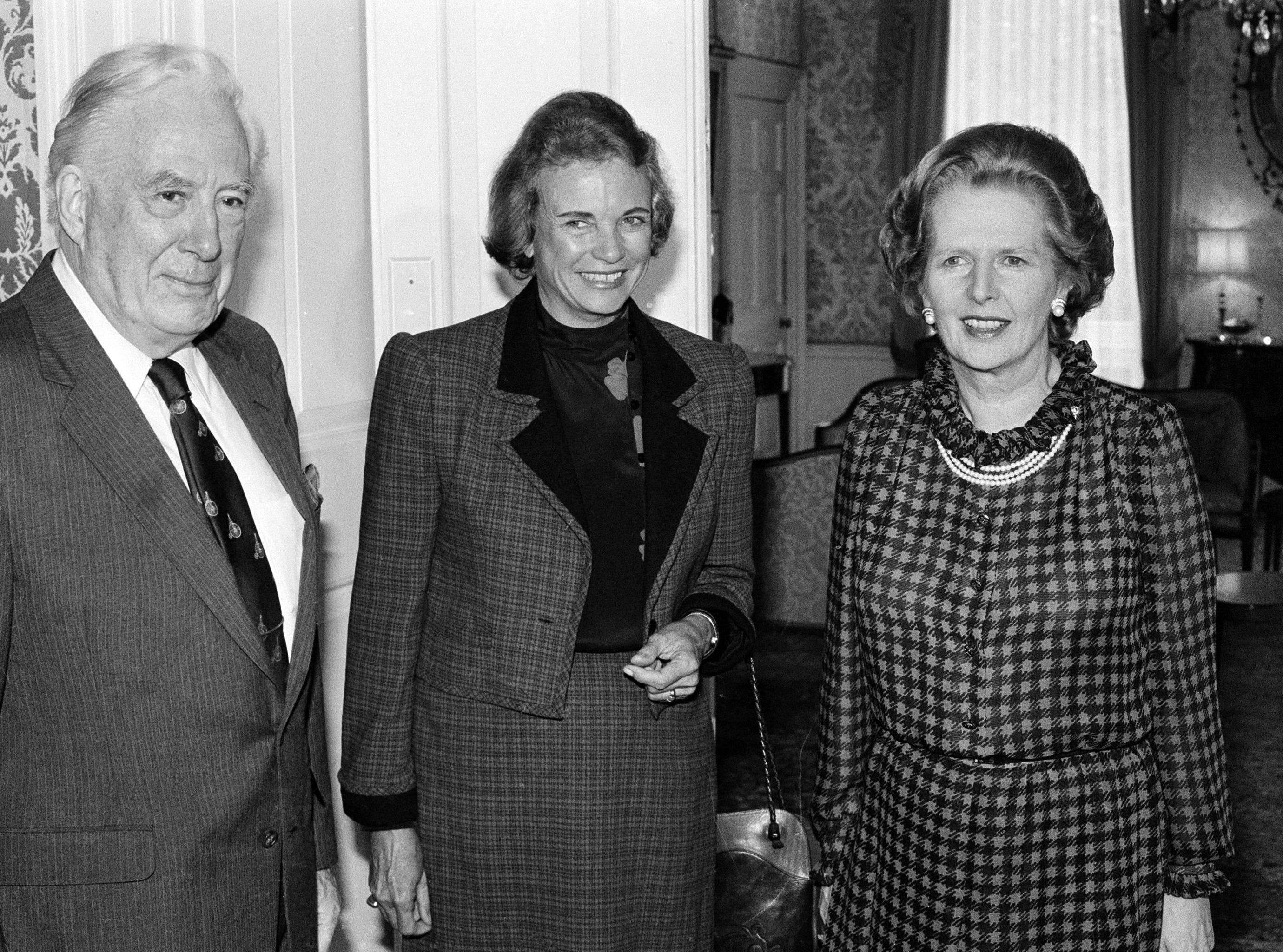 Britain's Prime Minister Margaret Thatcher poses with U.S. Chief Justice Warren Burger, and U.S. Supreme Court Judge Sandra Day O'Connor, prior to talks at 10 Downing Street in London, July 25, 1984.