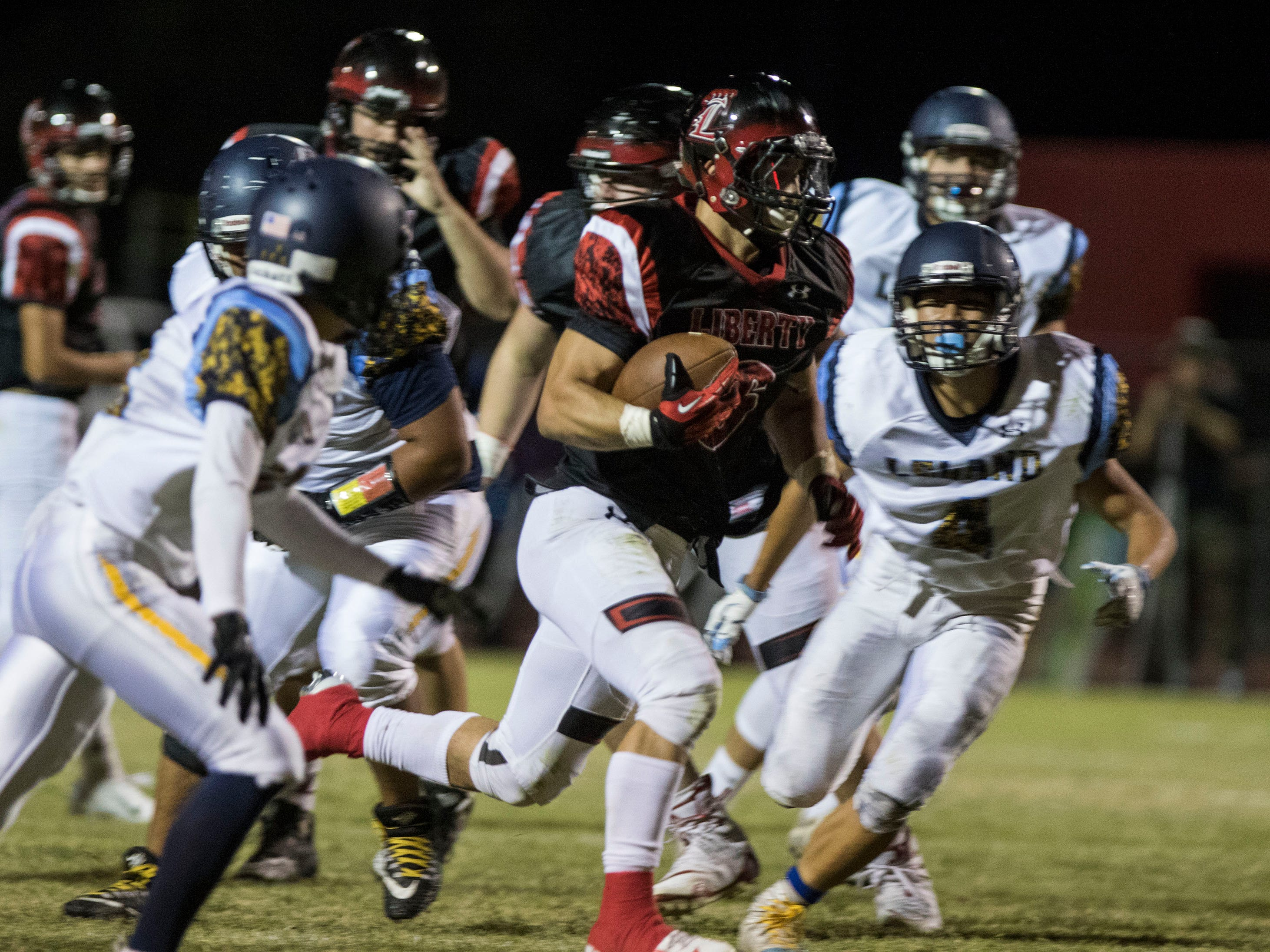 Liberty's Jett Kinsch out runs the Leland defense on his way to a touchdown during their game in Peoria Friday, Sept.14, 2018. #azhsfb