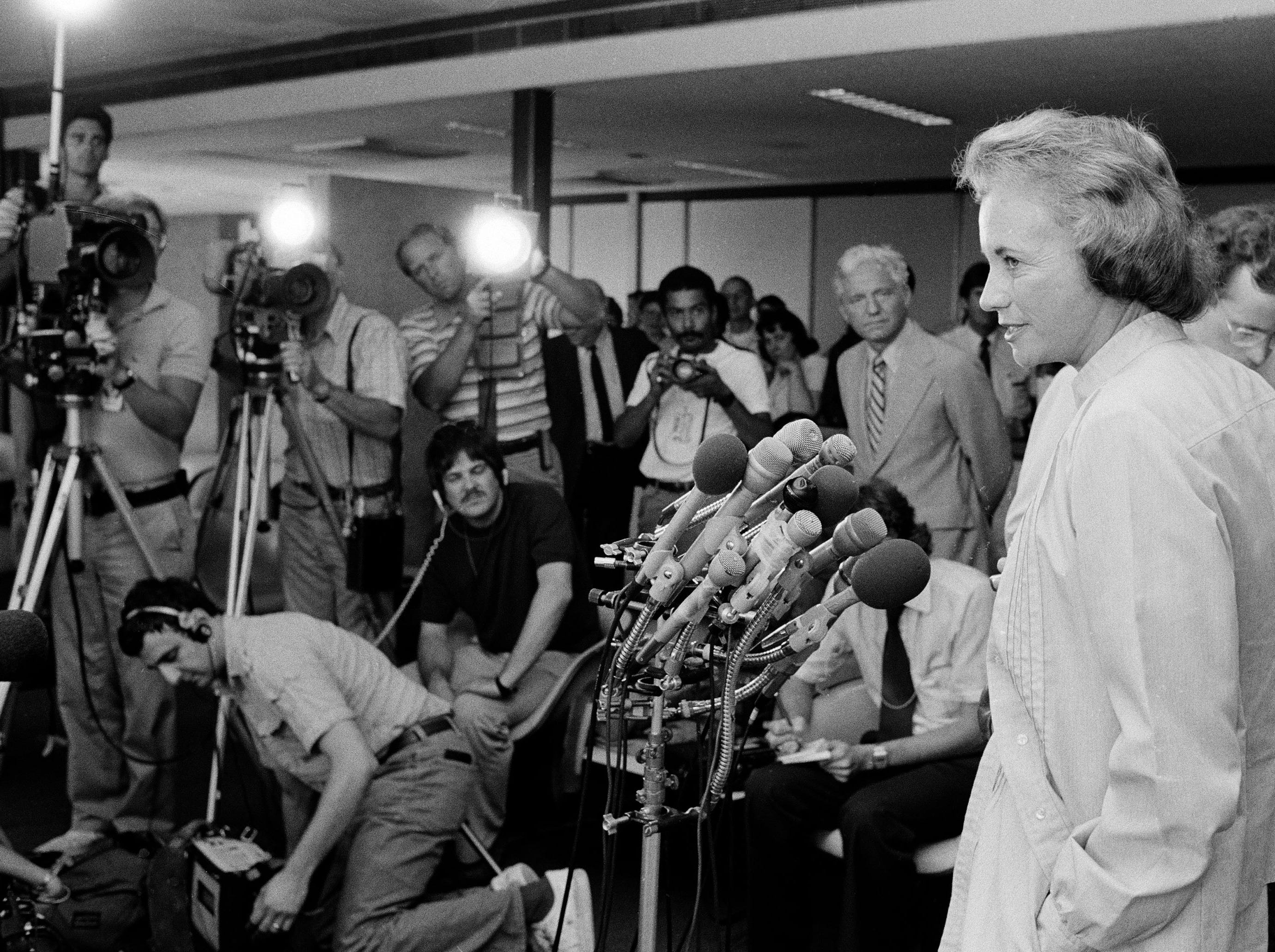 Sandra Day O'Connor, Pres. Reagan's nominee to the Supreme Court, answers questions for reporters on her arrival at Washington National Airport, July 14, 1981.